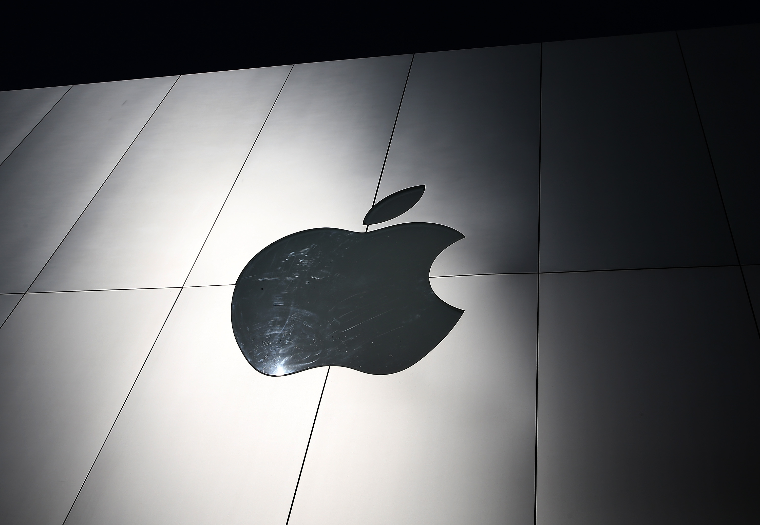 The Apple logo is displayed on the exterior of an Apple Store on April 23, 2013 in San Francisco, Calif.