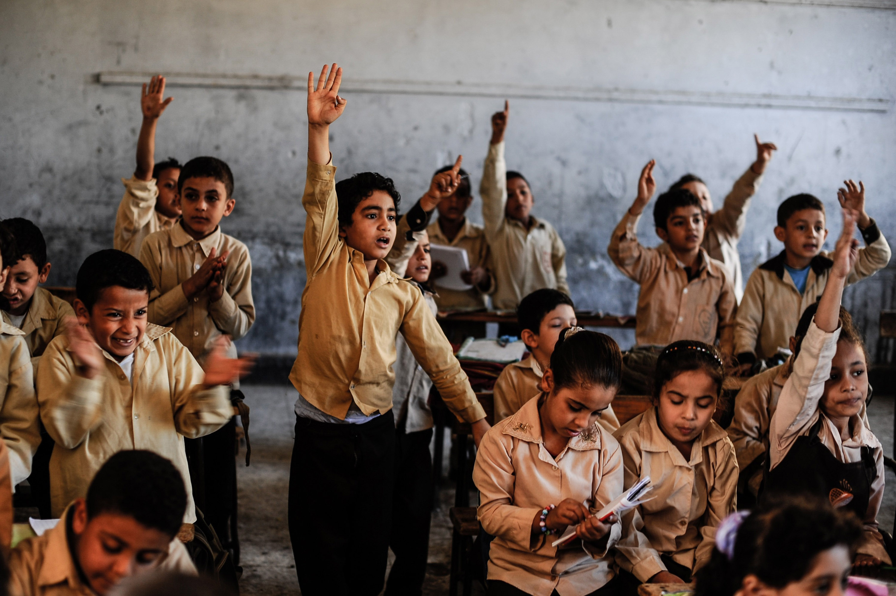 Elementary school students in Giza, Egypt, face big class sizes and poor equipment and facilities.