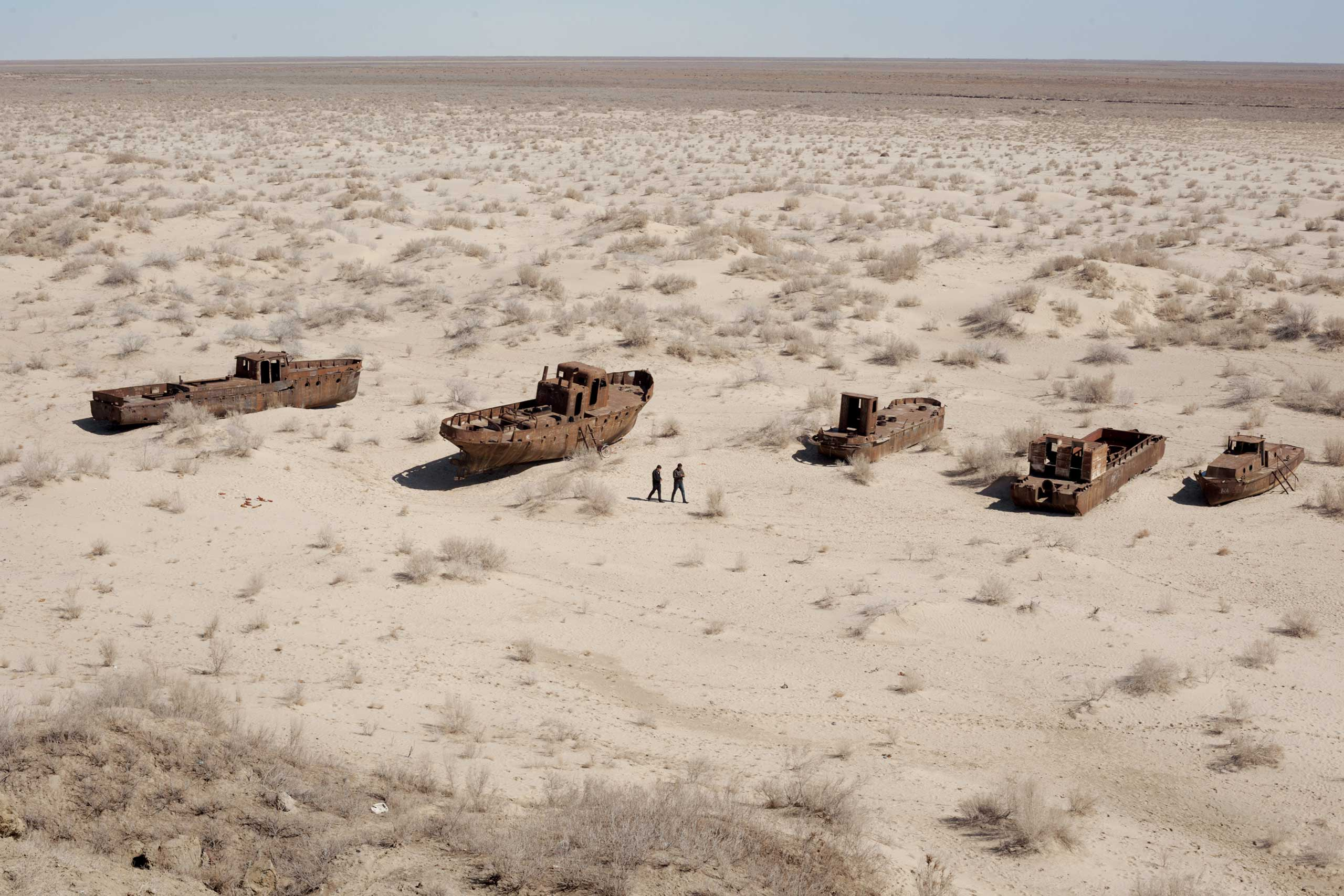 From the June  issue of National Geographic magazine: Sins of the Aral Sea                               Each of these boats used to haul in tons of fish every year. The fleet has been rusting near the former Uzbek port of Muynoq since the Aral dried up here in the 1980s.