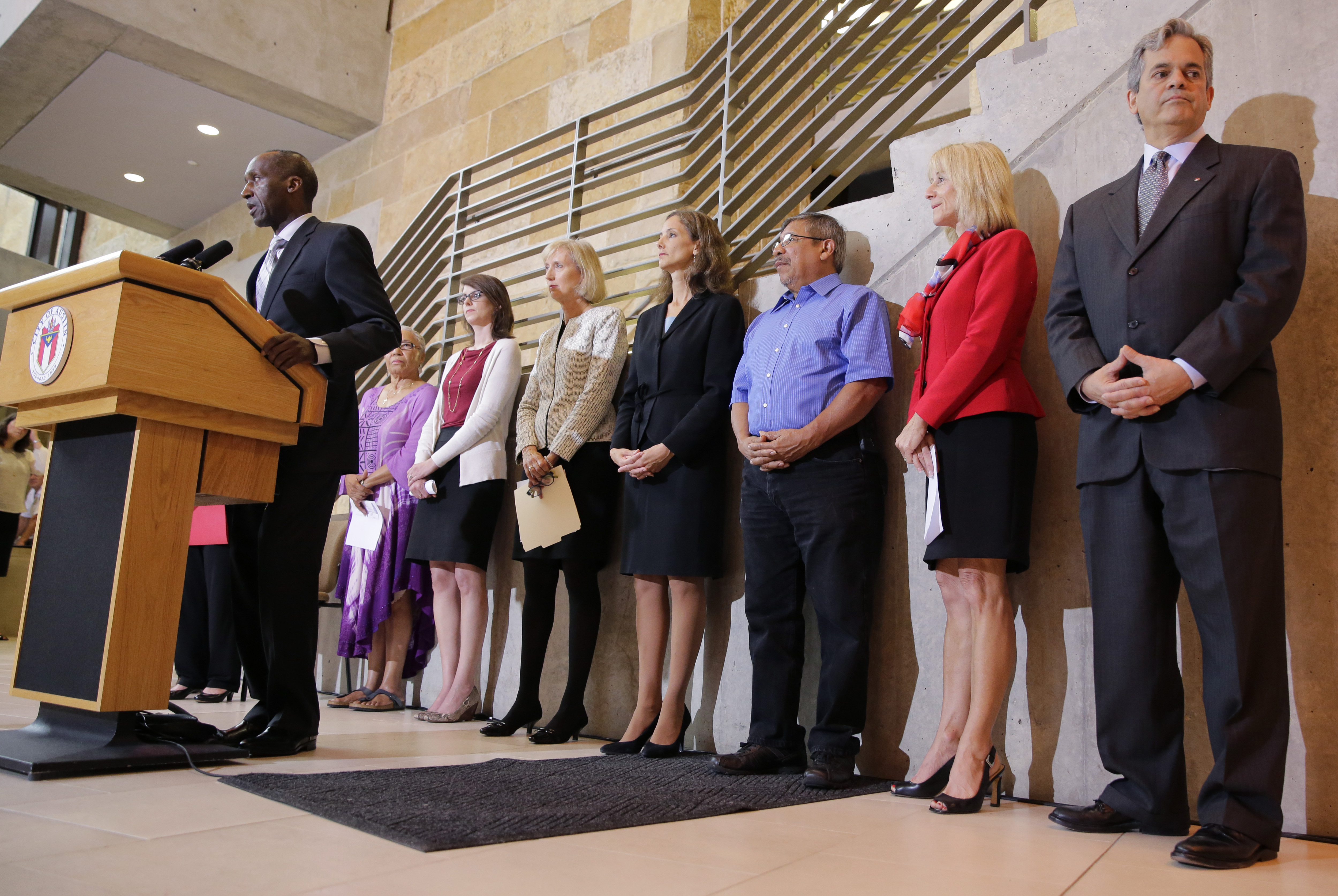 Members of the Austin city council listen to city manager Marc Ott during a news conference at City Hall, on May 13, 2015, in Austin, Texas.