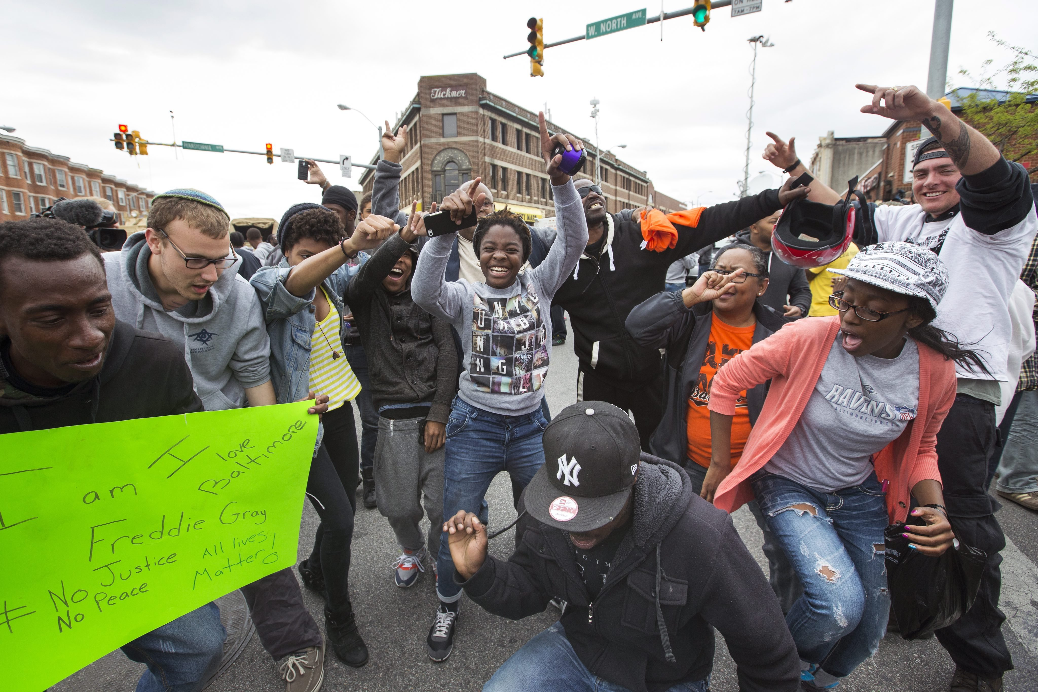 People celebrate in the streets of the Sandtown neighborhood in Baltimore after State Attorney Marilyn Mosby announced that six police officers are being charged in the death of Freddie Gray, in Baltimore on May 1, 2015.