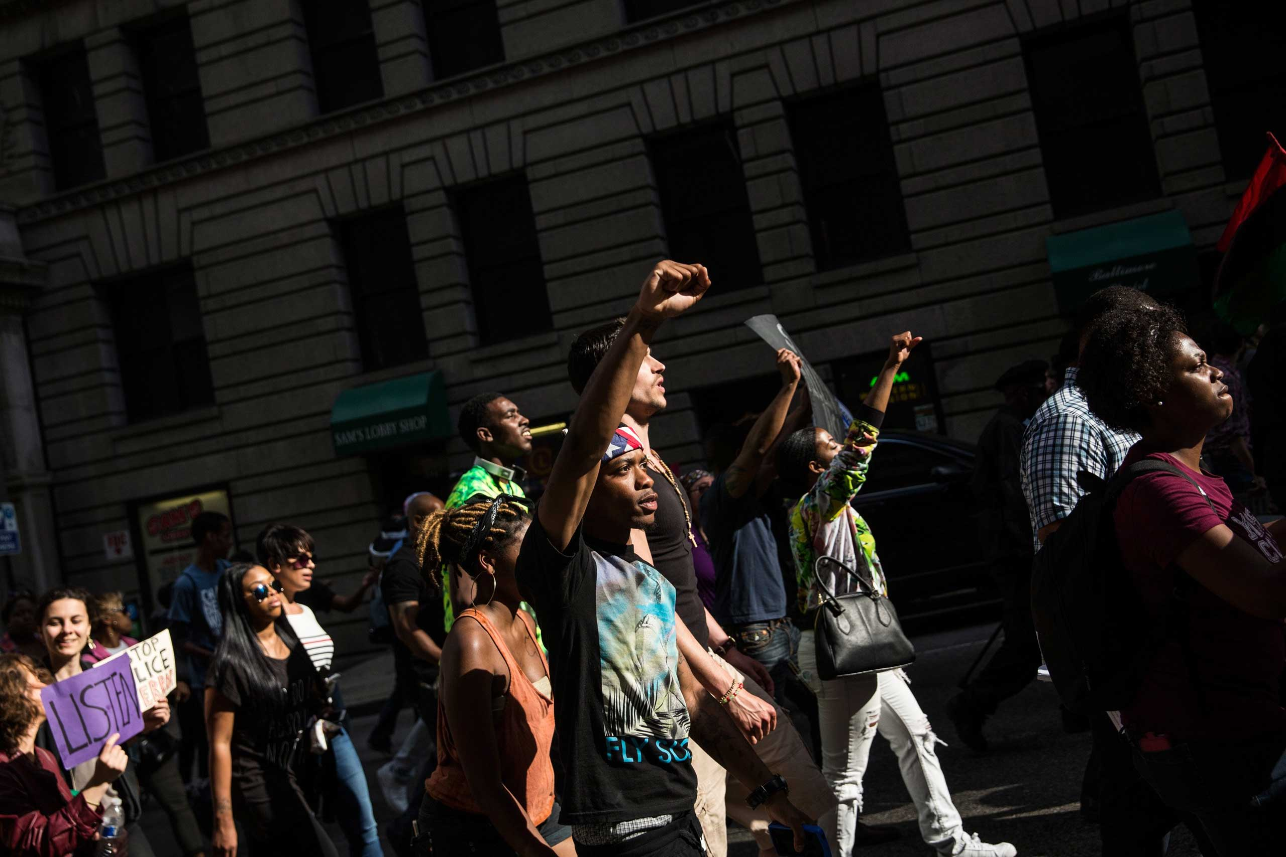 Protesters march from City hall to the Sandtown neighborhood in Baltimore on May 2, 2015.