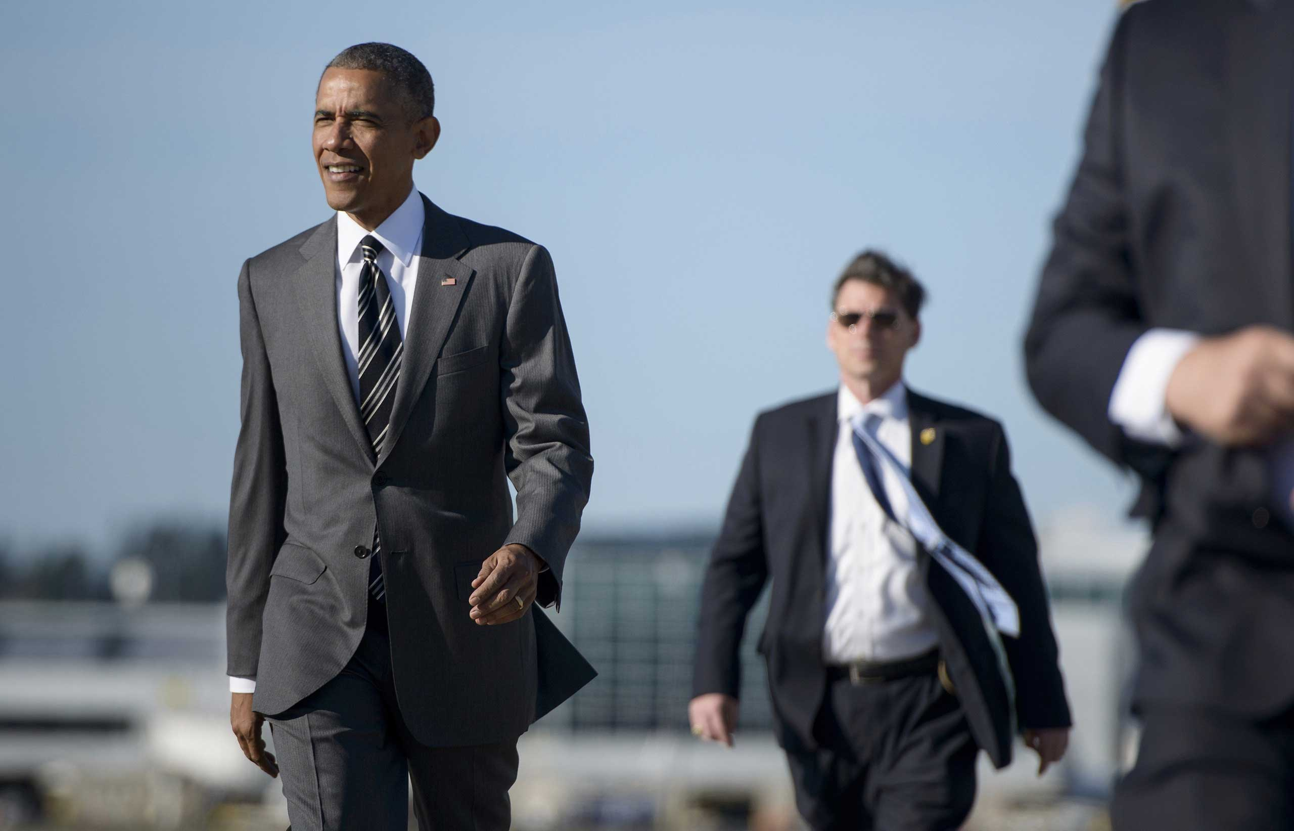 President Barack Obama arrives at the Oregon Air National Guard Base ahead of a fundraiswer at Nike, in Portland on May 7, 2015.
