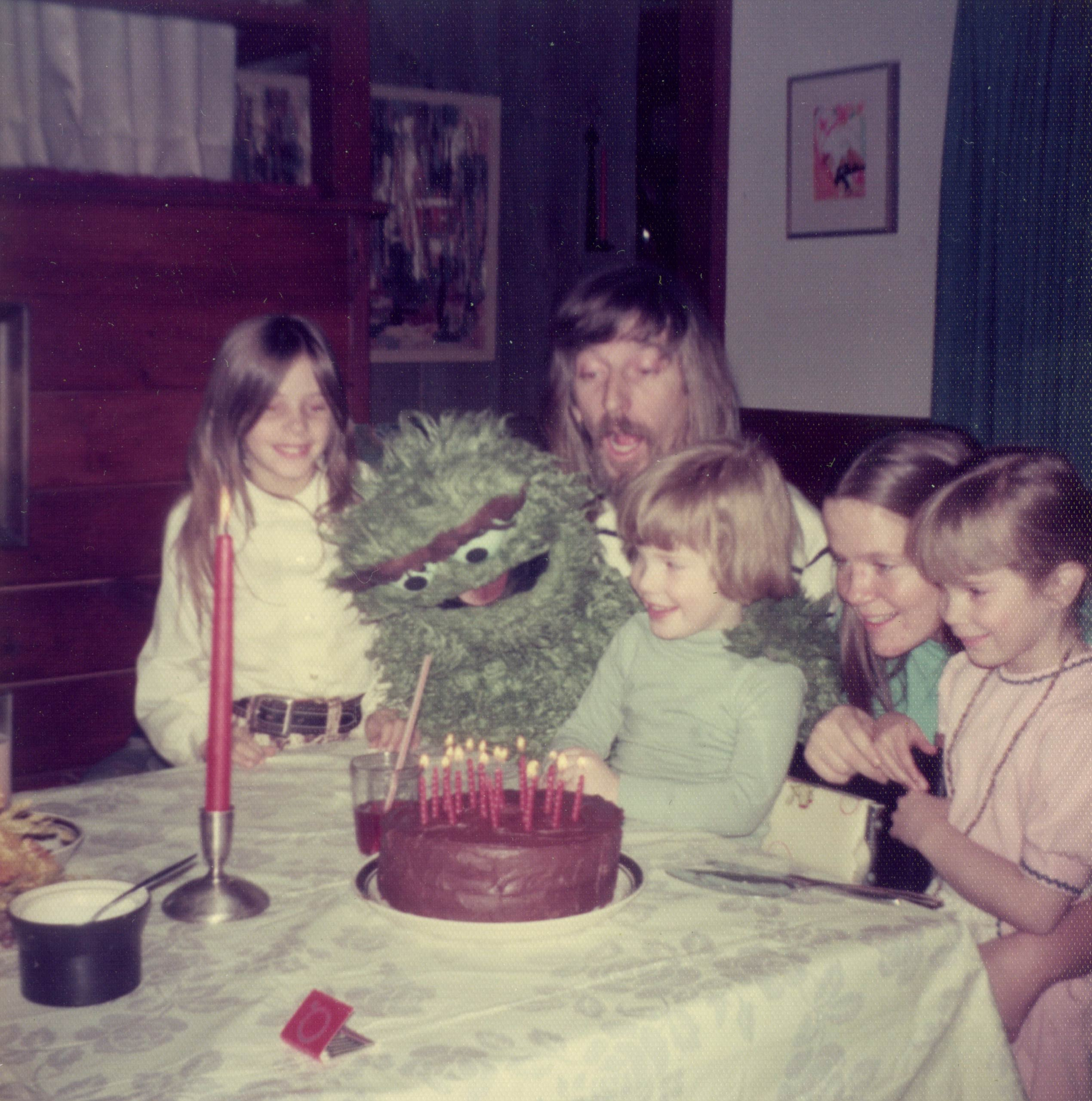 Caroll Spinney with his children and Oscar the Grouch at his child's birthday party.