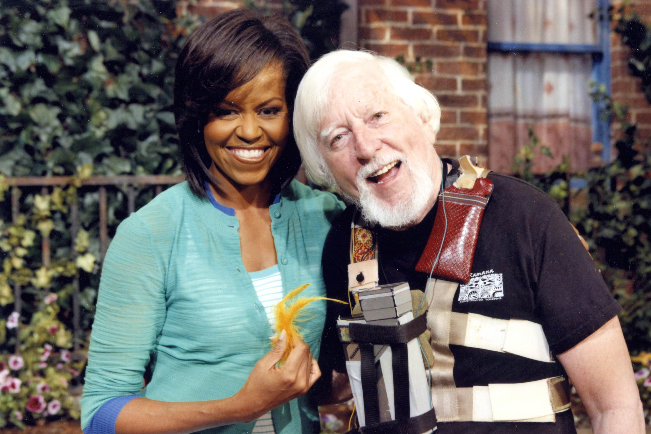 Caroll Spinney is seen with First Lady Michelle Obama. Spinney is a distant cousin of President Barack Obama.