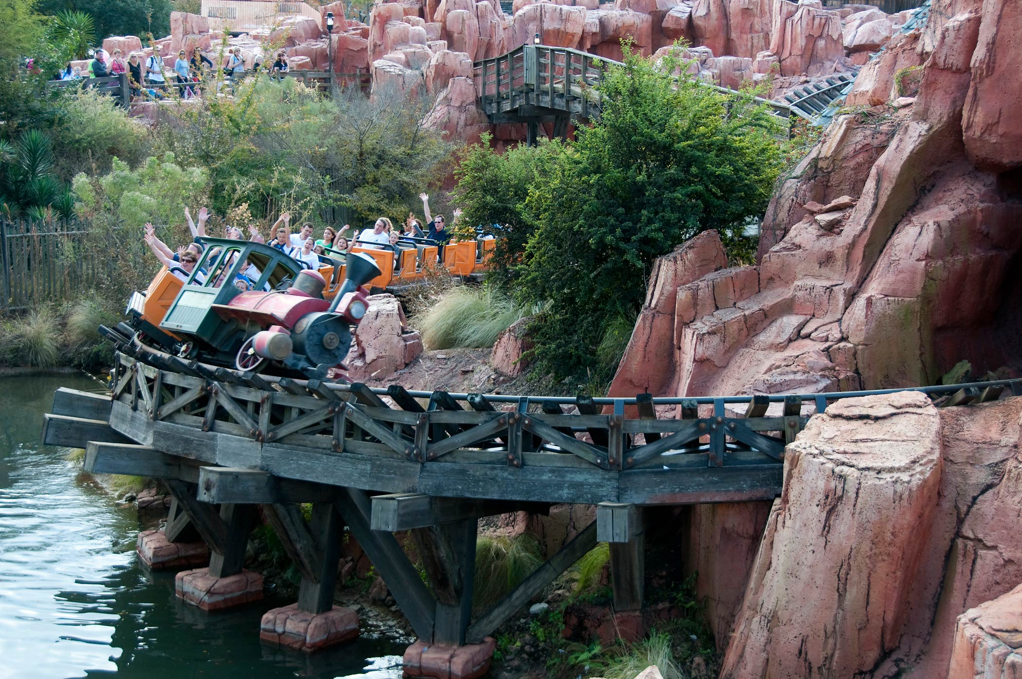 Tourists ride the Big Thunder Mountain Railroad in Disney World in Orlando, Fla.