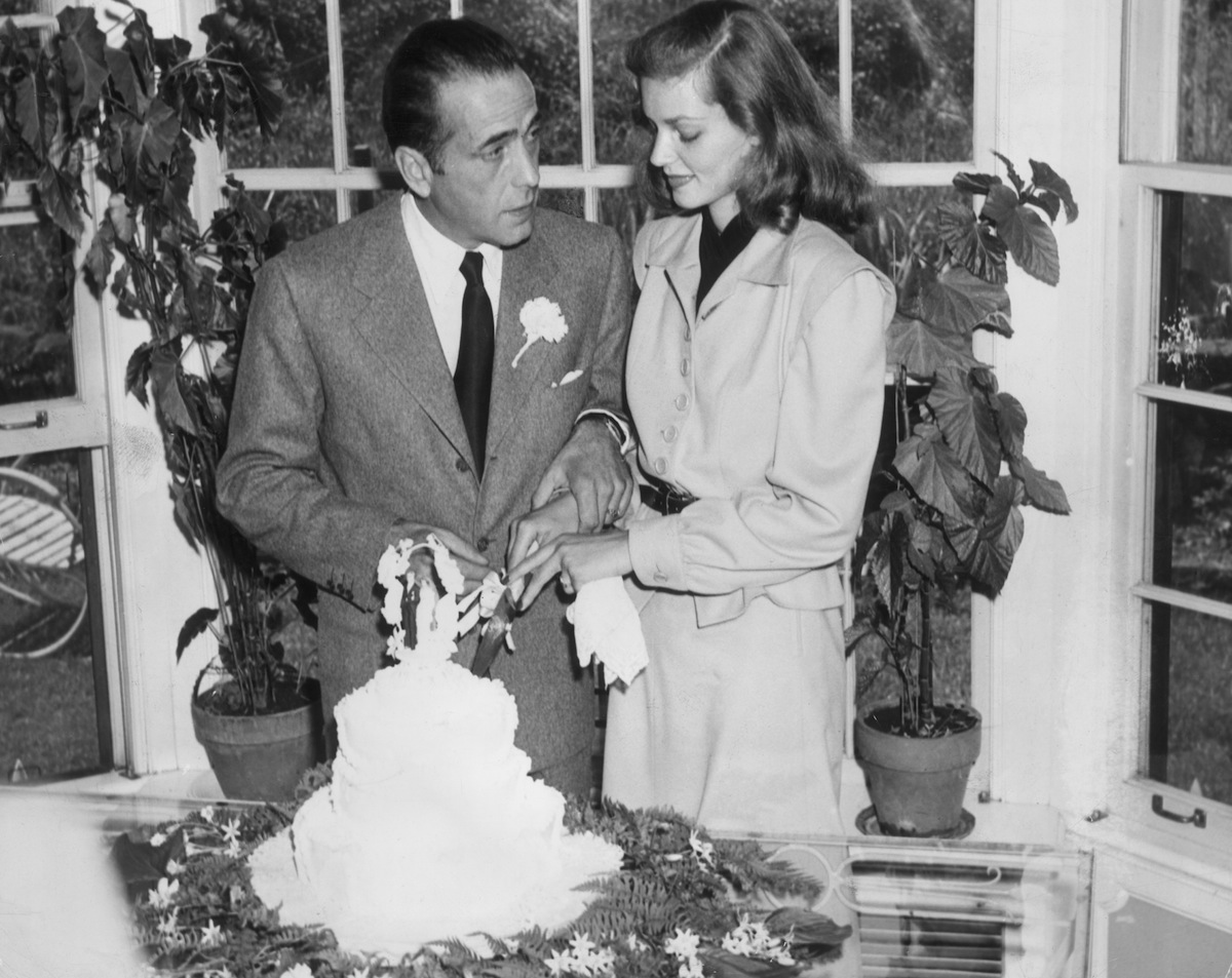 Lauren Bacall and Humphrey Bogart cut the cake at their wedding on May 21, 1945