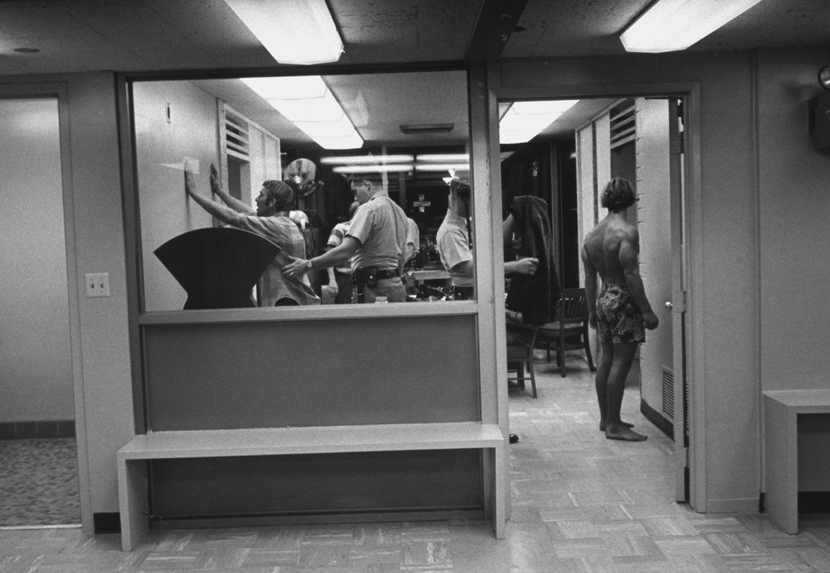 Suspects being searched for narcotics at the US-Mexico border customs post in 1969