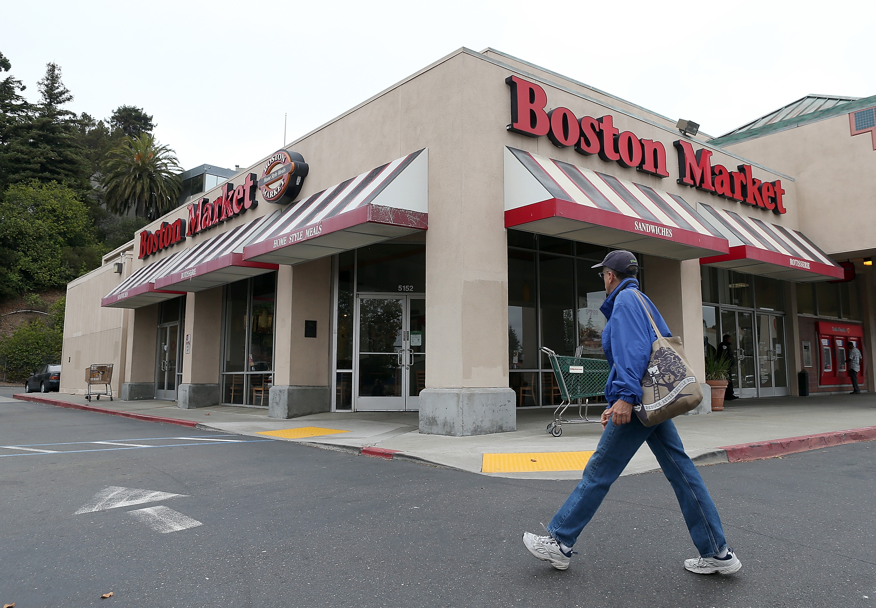 A man walks by a Boston Market restaurant on August 21, 2012 in Oakland, Calif.