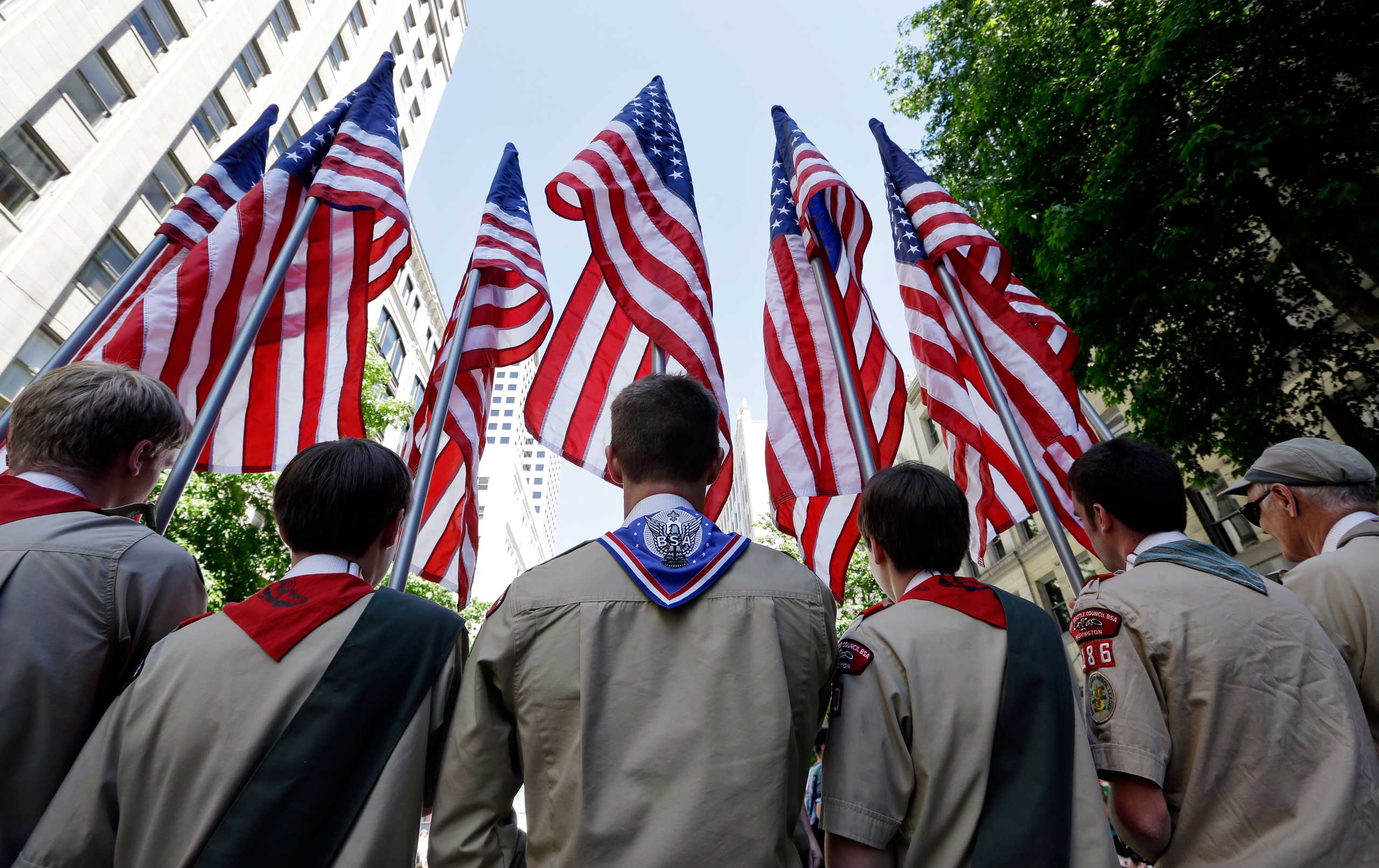 Boy Scouts from the Chief Seattle Council carry U.S. flags as they prepare to march in the Gay Pride Parade in downtown Seattle on June 30, 2013.
