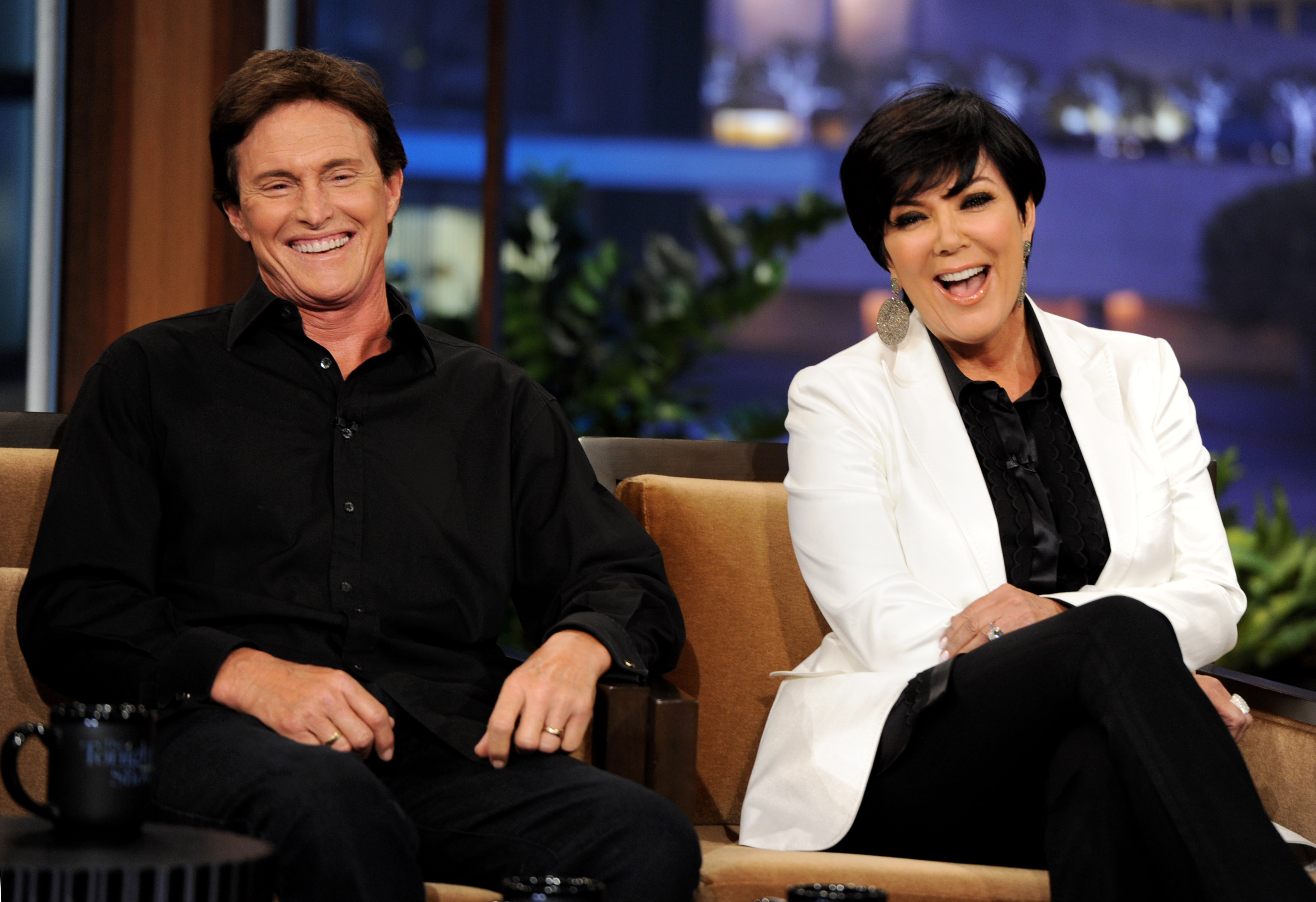 Television personalities Bruce Jenner (L) and his wife Kris Jenner appear on The Tonight Show with Jay Leno at the NBC Studios on June 10, 2011 in Burbank, Calif.