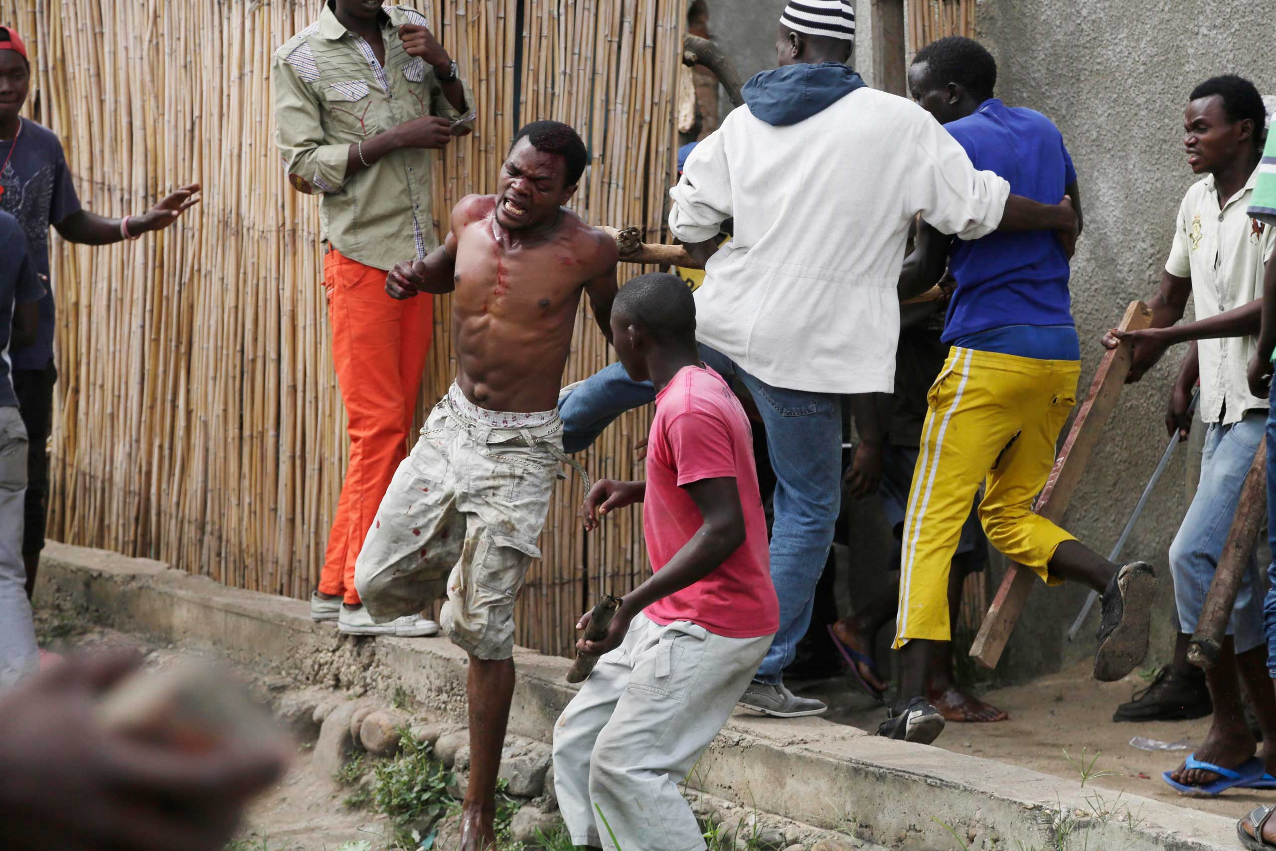 Niyonzima flees from his house while surrounded  by a mob.
