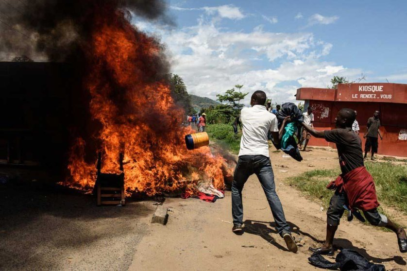 People burn mattresses looted from the local police post neighborhood in Bujumbura, during a protest against incumbent president Pierre Nkurunziza's bid for a 3rd term on May 13, 2015.