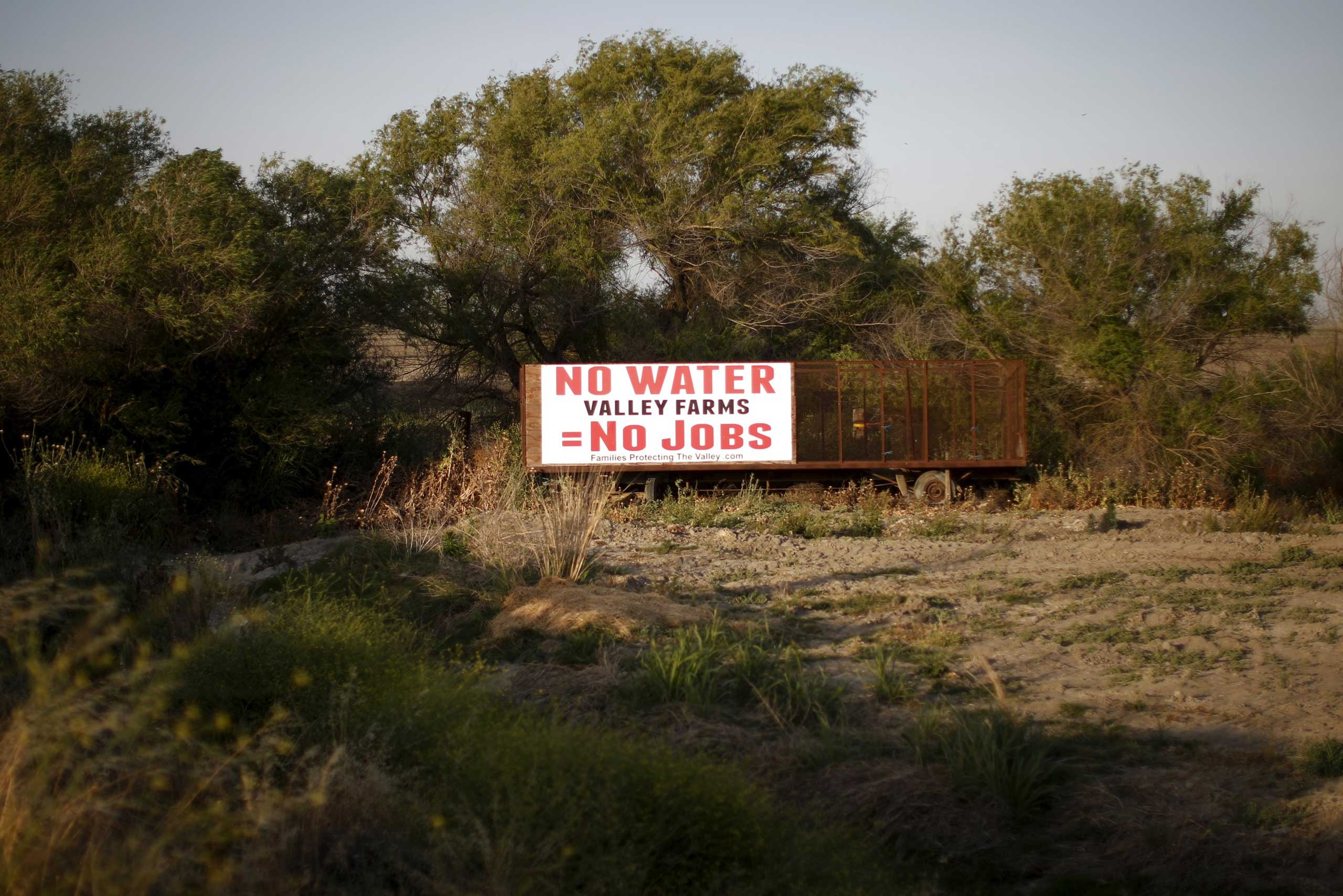 A water protest sign is seen in Los Banos, California, United States May 5, 2015. Central Valley counties suffer some of the highest unemployment rates in the state, topping out at more than 20% in Colusa County, according to the state's Legislative Analyst's Office.