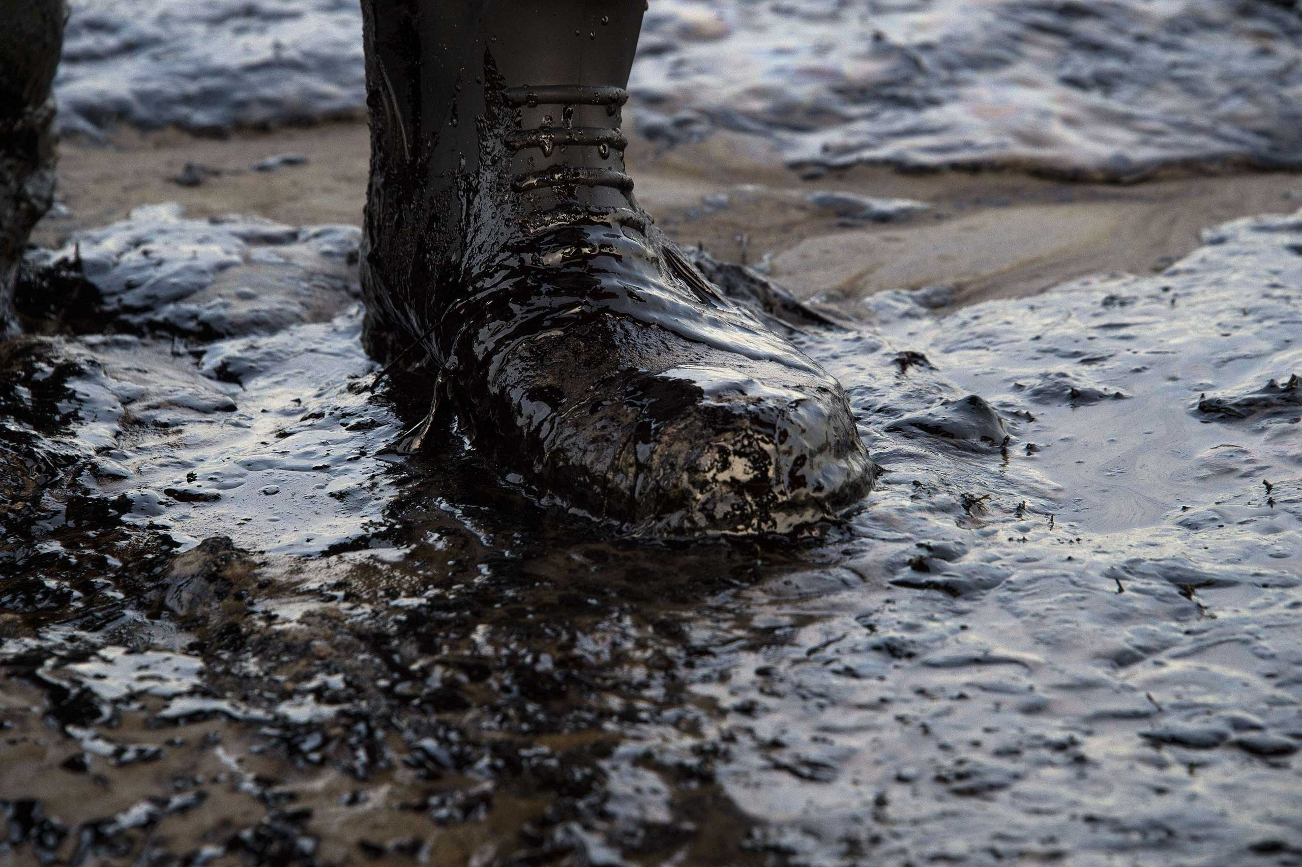 Oil covers a local resident's boot at Refugio State Beach in Goleta, Calif. on May 19, 2015.