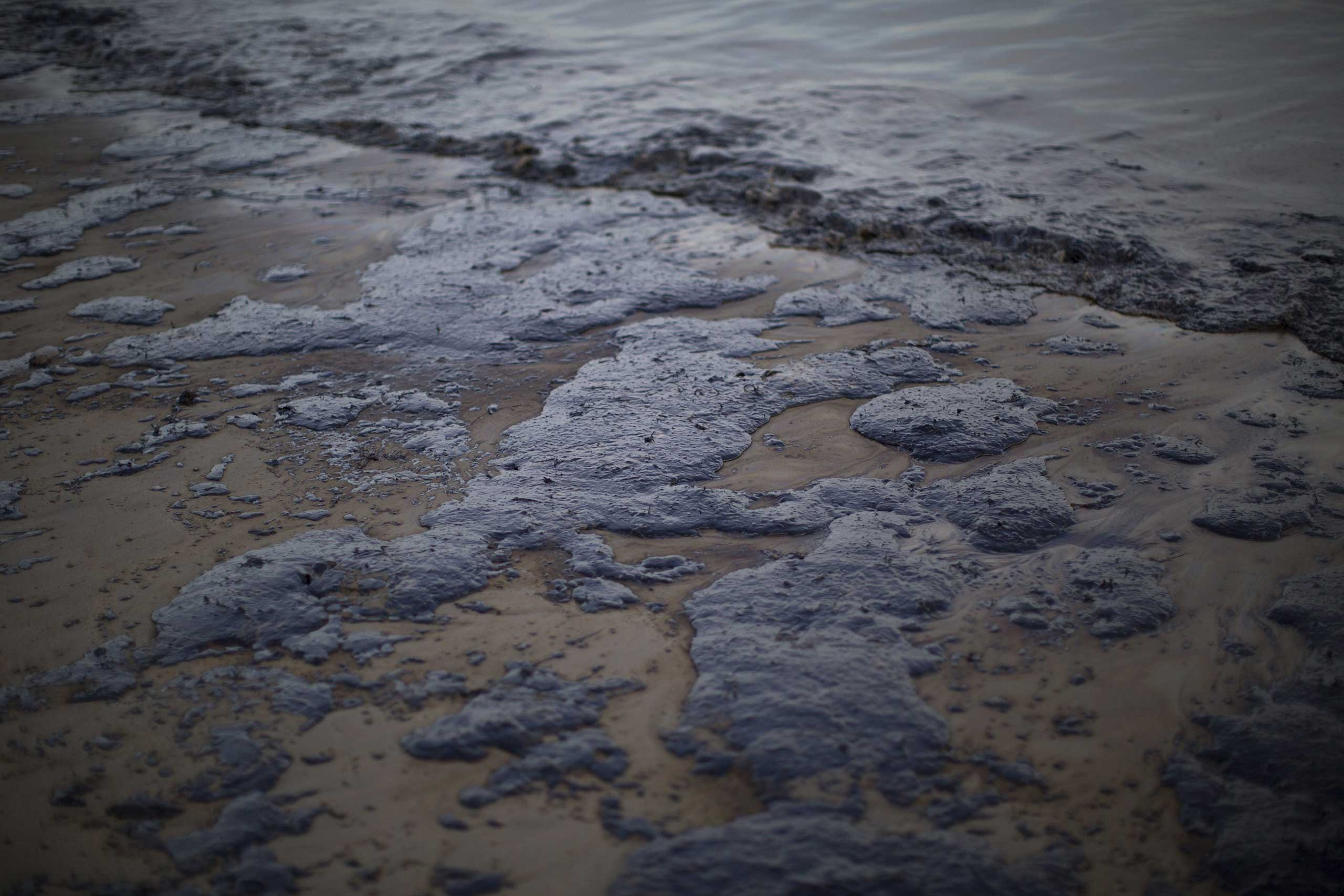 Spilled oil covers the coast at Refugio State Beach in Goleta, Calif. on May 19, 2015.