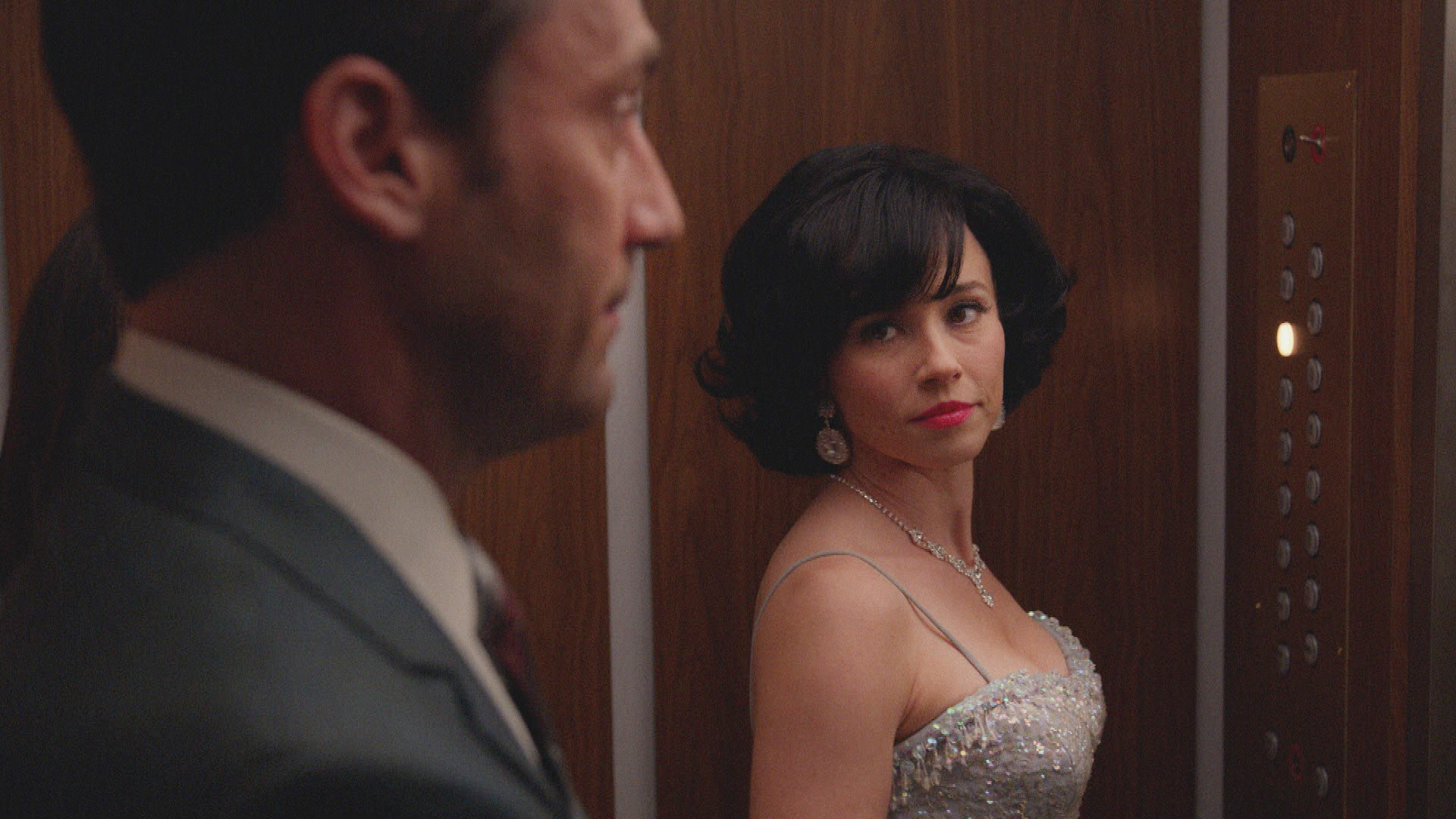 Jon Hamm as Don Draper and Linda Cardellini as Sylvia Rosen on  Mad Men,  Season 7B, Episode 9.