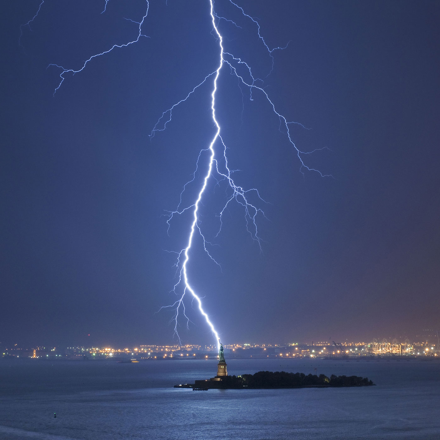 Lightning strikes near the Statue of Liberty in New York City, Oct. 11, 2010.