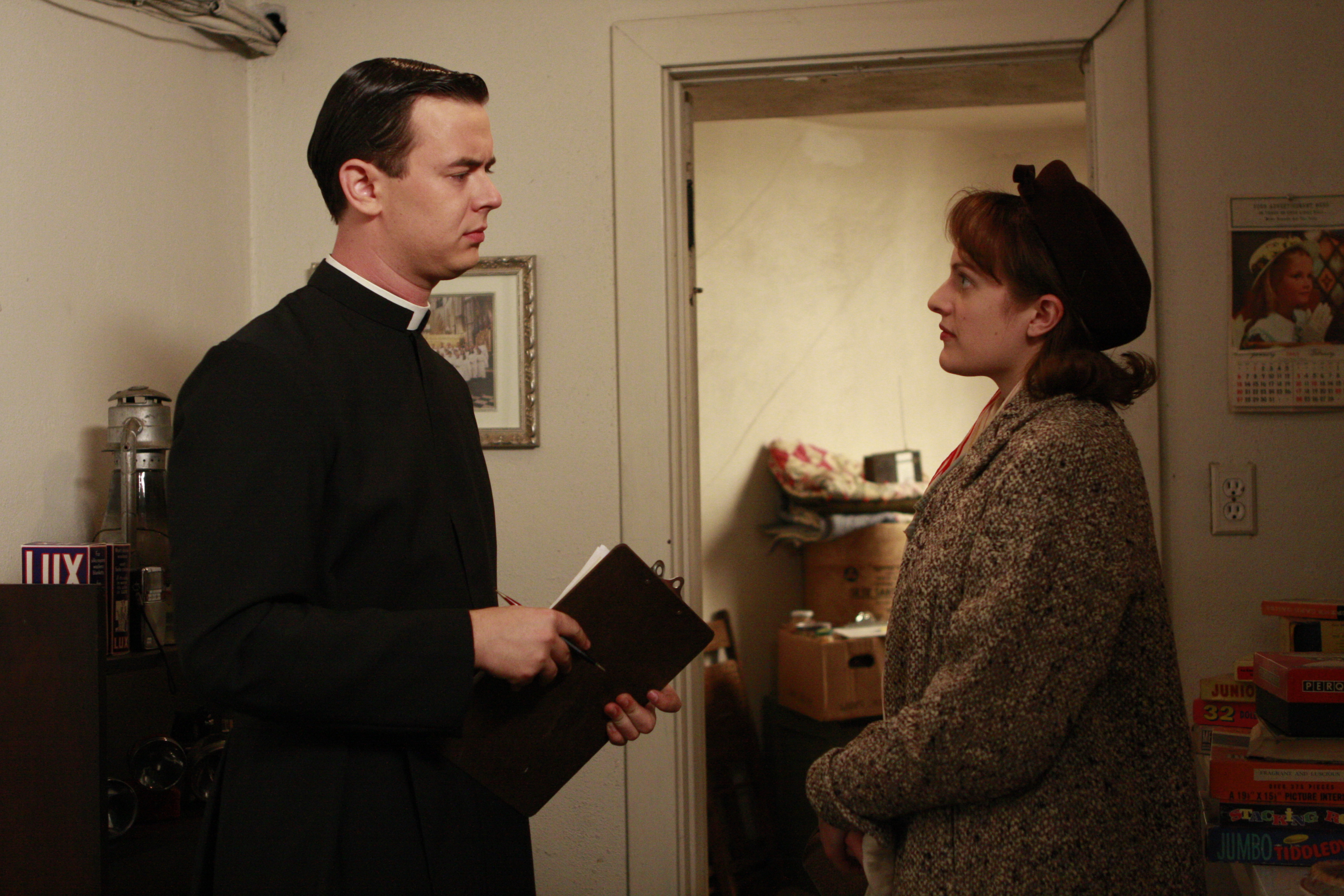 Father John Gill (Colin Hanks) and Peggy Olson (Elisabeth Moss) - Mad Men - Season 2, Episode 13 - Photo Credit: Carin Baer/AMC