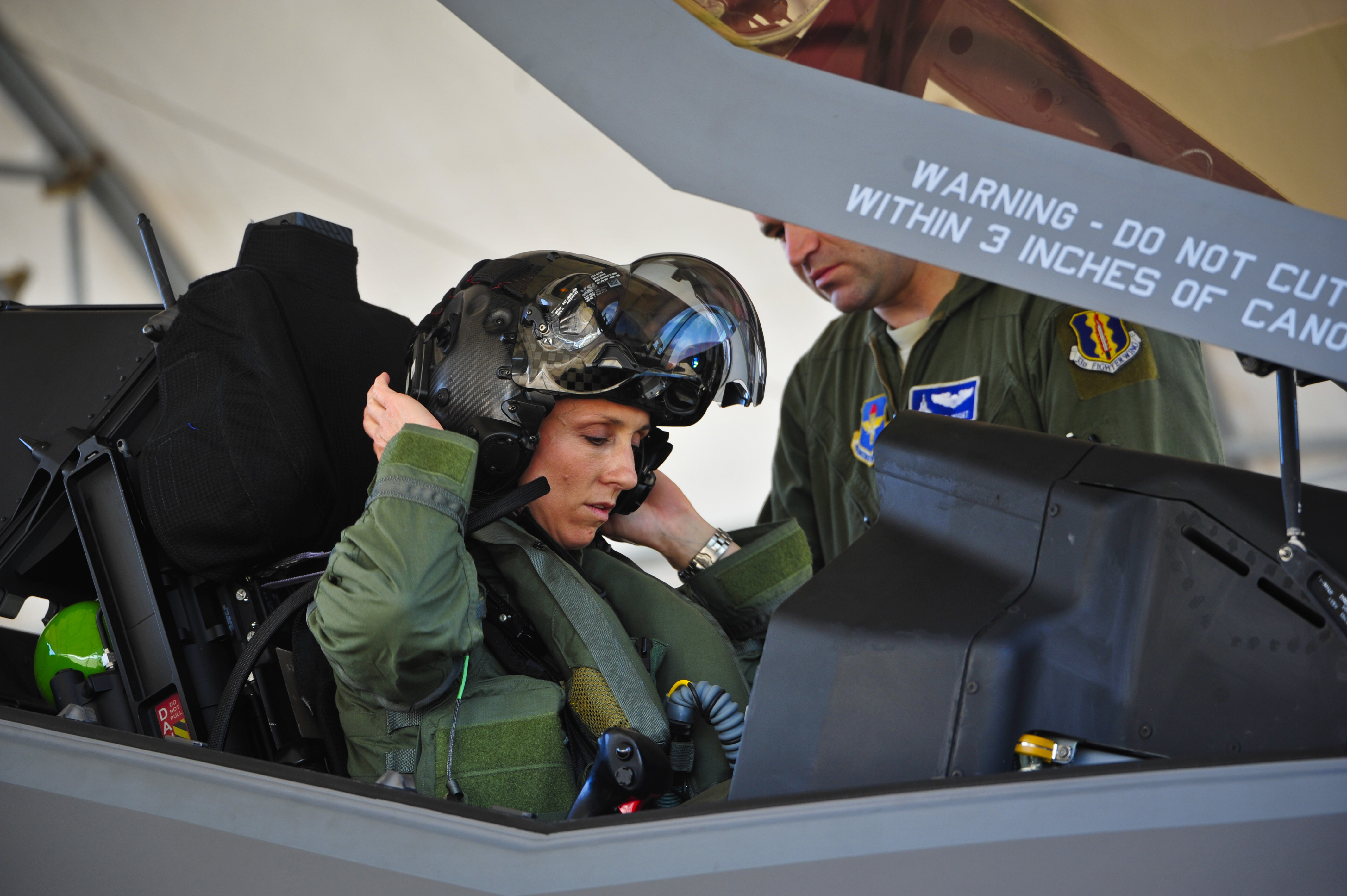 Lt. Col. Christine Mau, 33rd Operations Group deputy commander, puts on her helmet before taking her first flight in the F-35A on Eglin Air Force Base, Fla., on May 5, 2015.