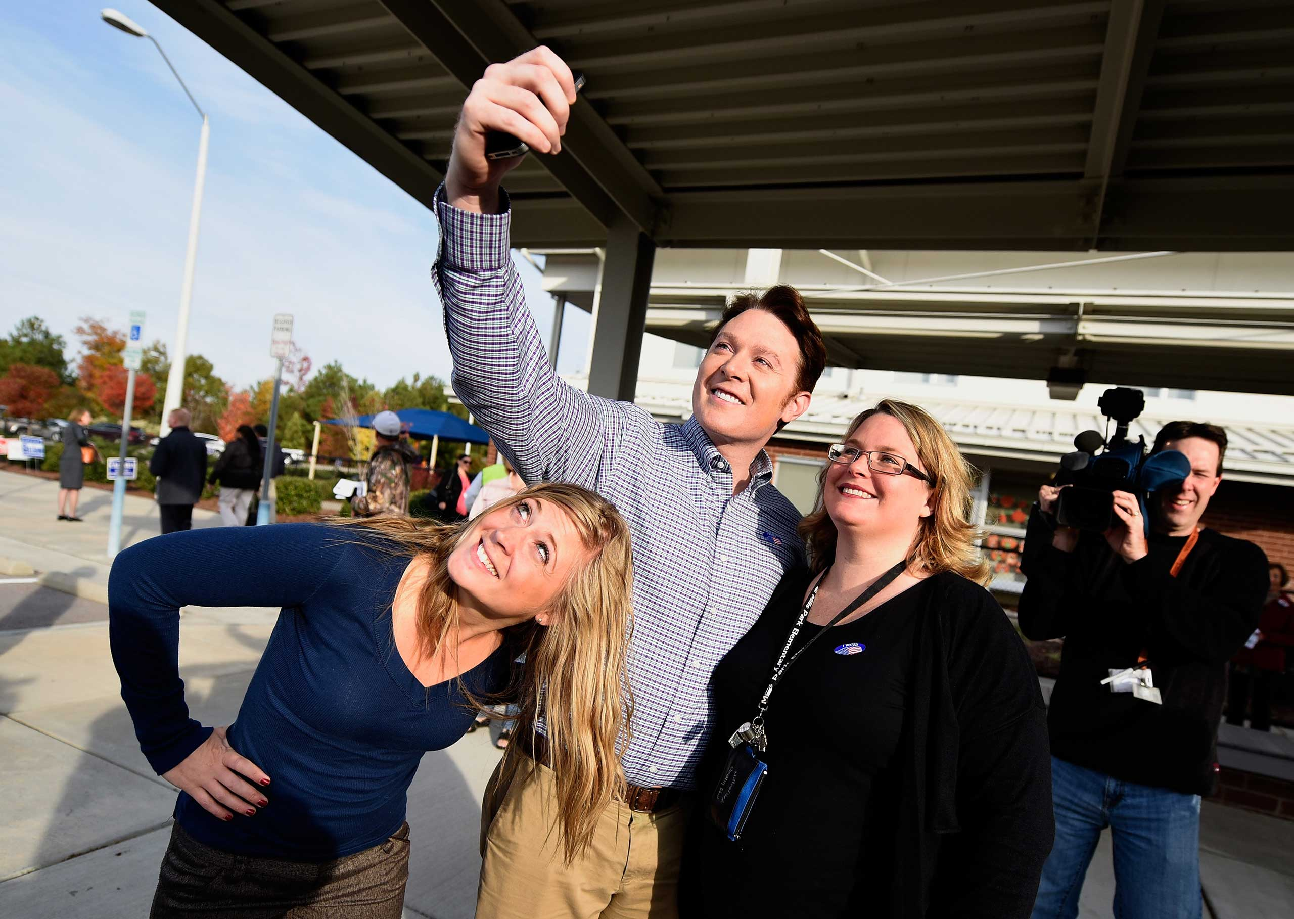 <b>Clay Aiken</b>, Democratic candidate for U.S. Congress in North Carolina's Second District, poses for a selfie with supporters after casting his vote in the midterm elections oat Mills Park Elementary School in Cary, N.C. on Nov. 4, 2014. Aiken was runner up on the second season of <i>American Idol</i>.