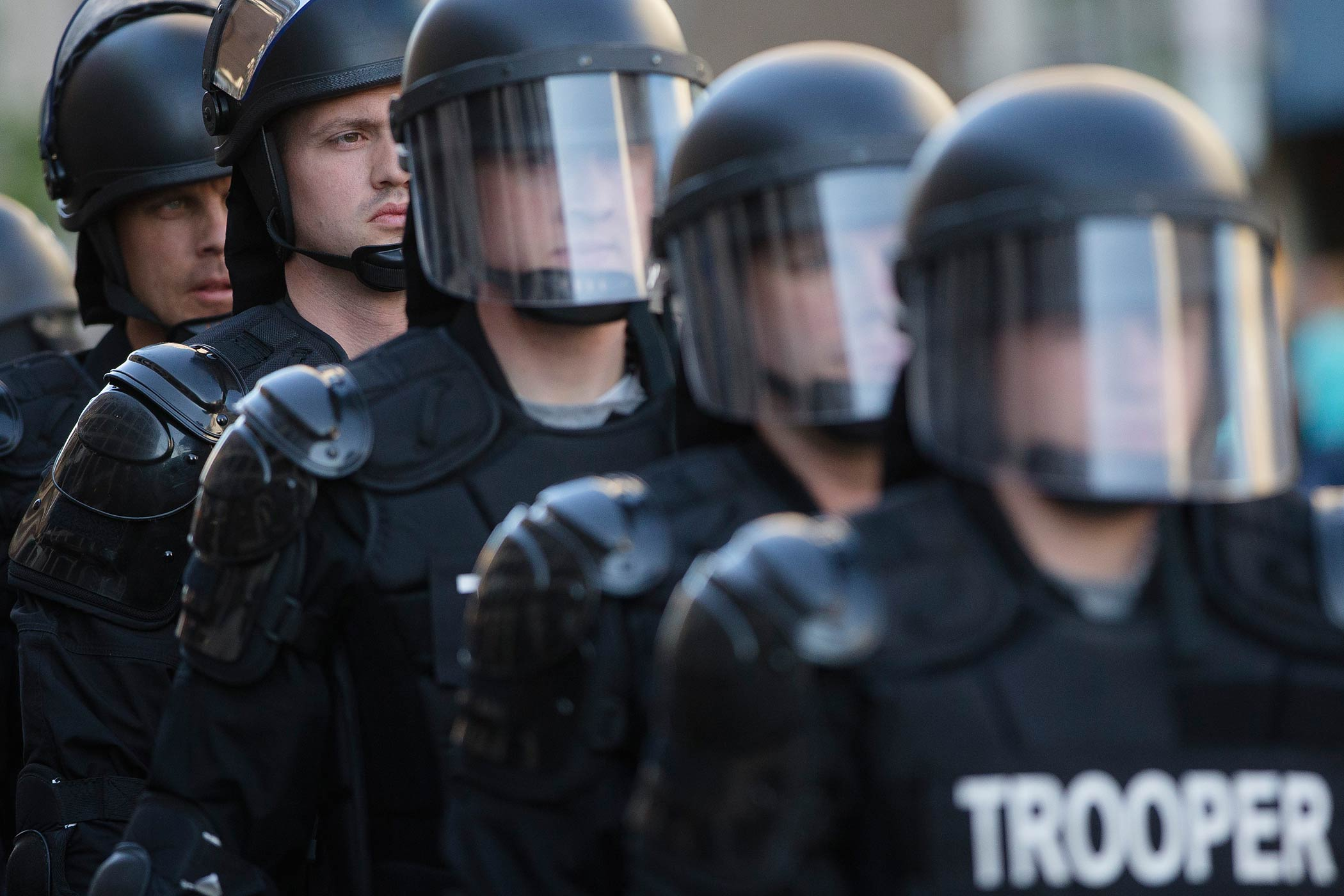 Riot police stand in formation as a protest forms against the acquittal of Michael Brelo, a patrolman charged in the shooting deaths of two unarmed suspects, on May 23, 2015, in Cleveland.