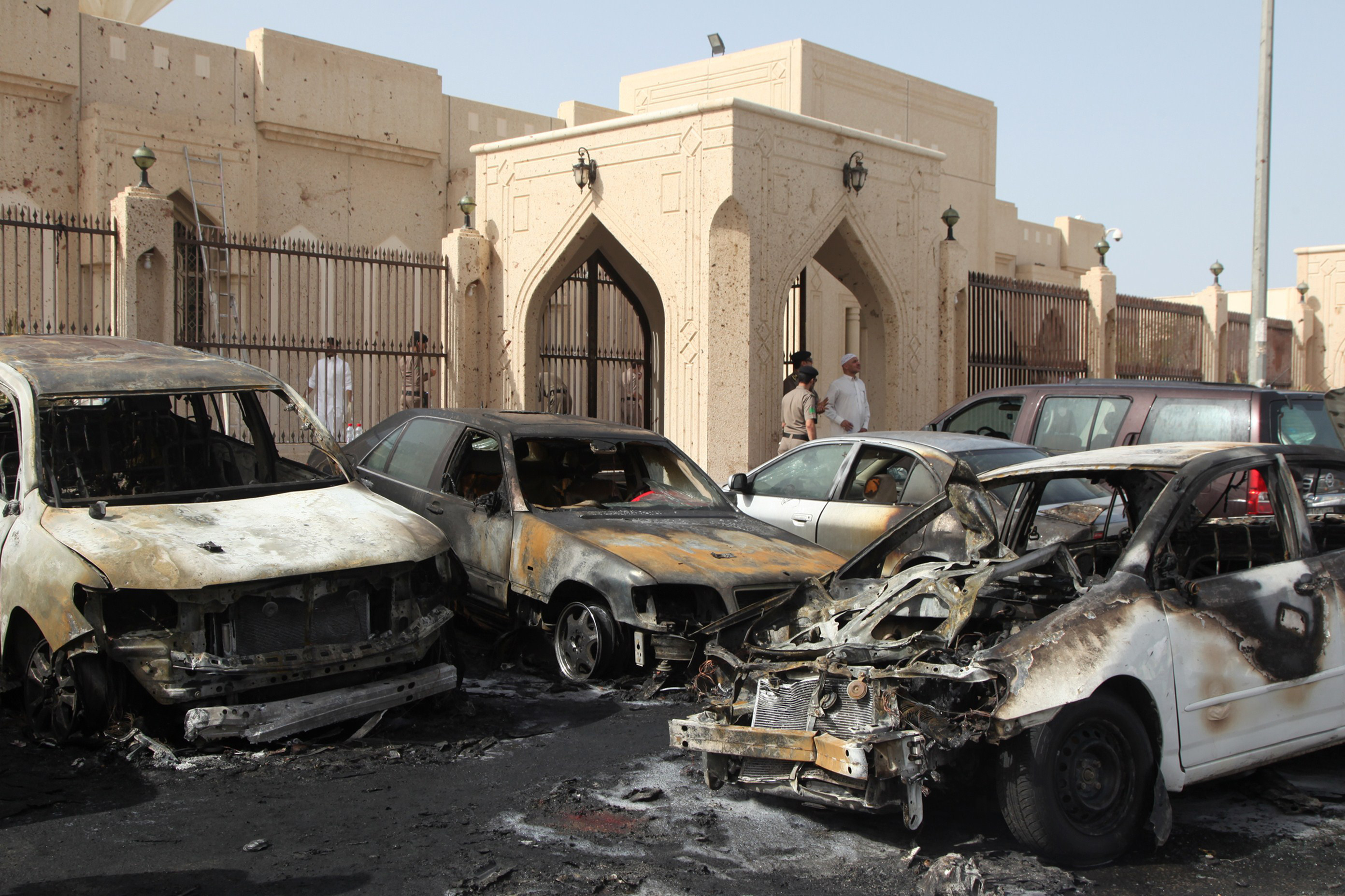Saudi security forces inspect the site of a suicide bombing that targeted the Shiite Al-Anoud mosque in the coastal city of Dammam on May 29, 2015.