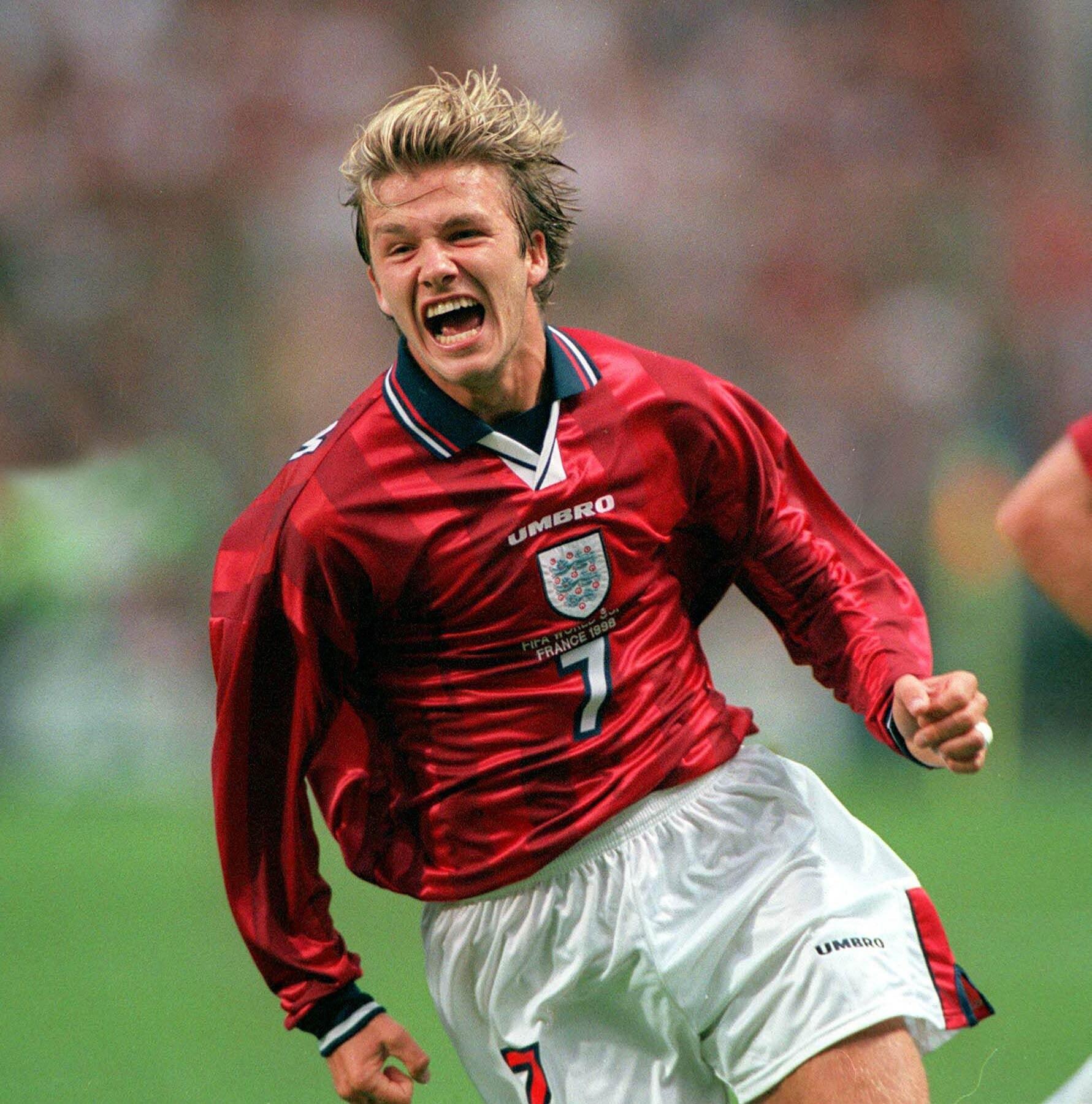 David Beckham celebrates after scoring a goal during the 1998 World Cup Finals in Lens, France.