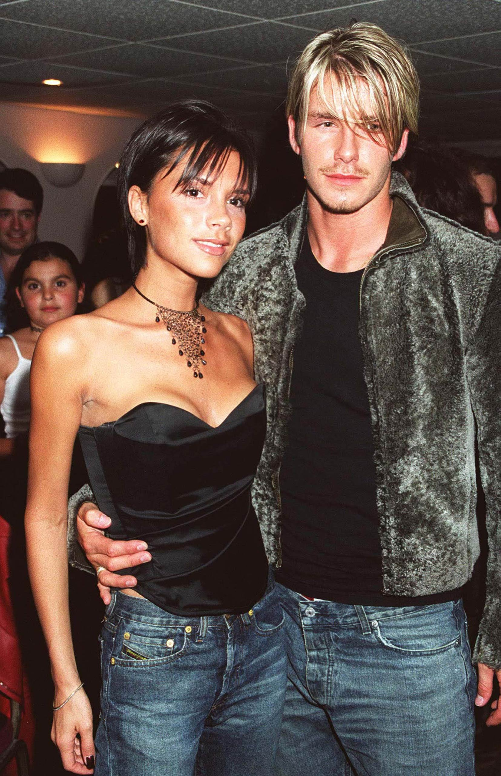 Victoria Adams and David Beckham are seen backstage after a Whitney Houston concert at Wembley Arena, London in 1999.
