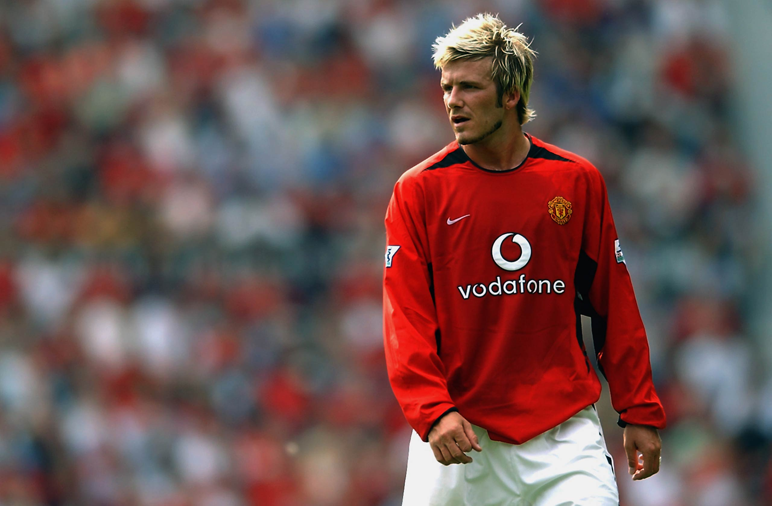 David Beckham of Manchester United plays during the Manchester United v West Bromwich Albion FA Barclaycard Premiership match at Old Trafford in Manchester, England in 2002.