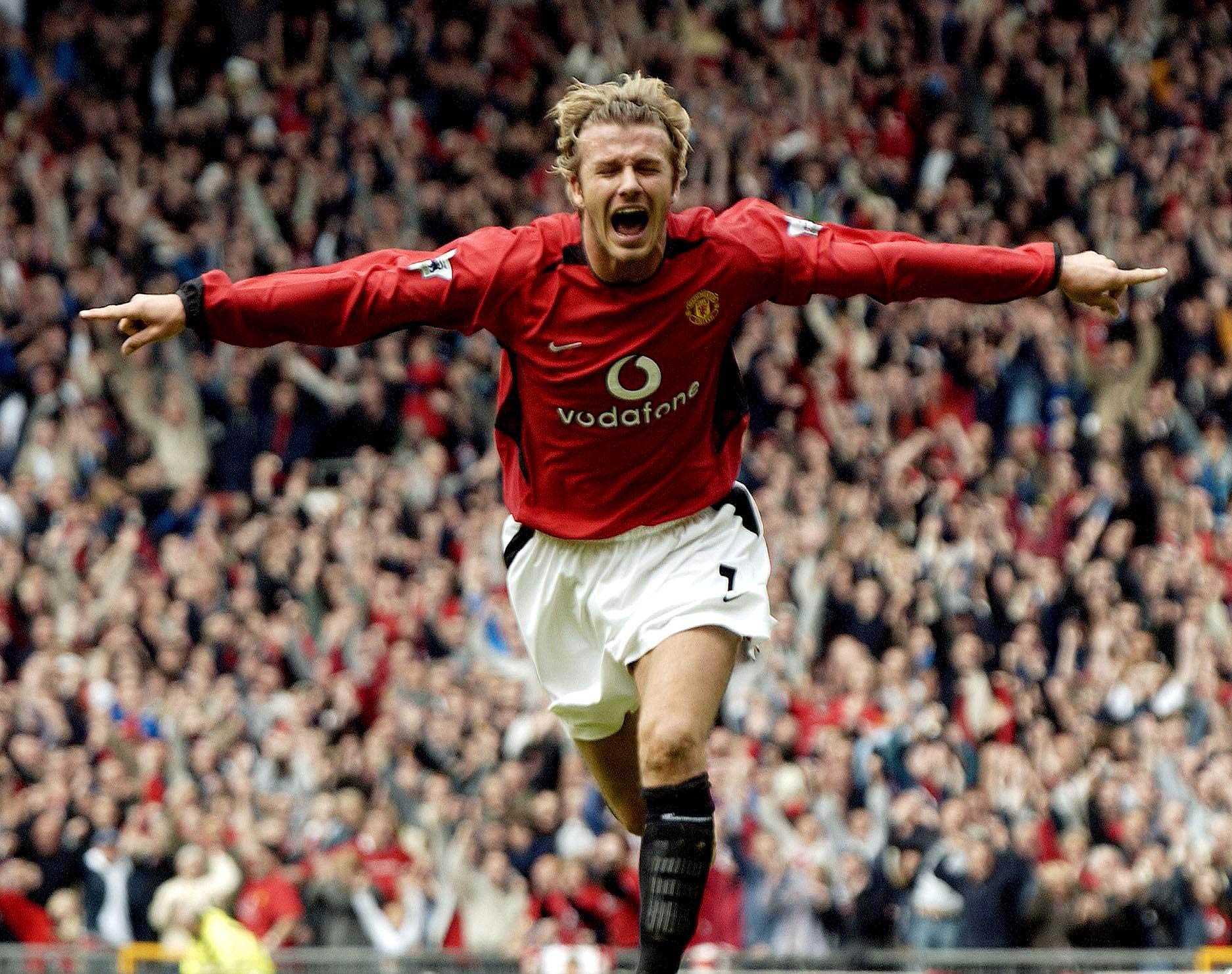 David Beckham celebrates after scoring during a match at Old Trafford, in Manchester, England in 2003.