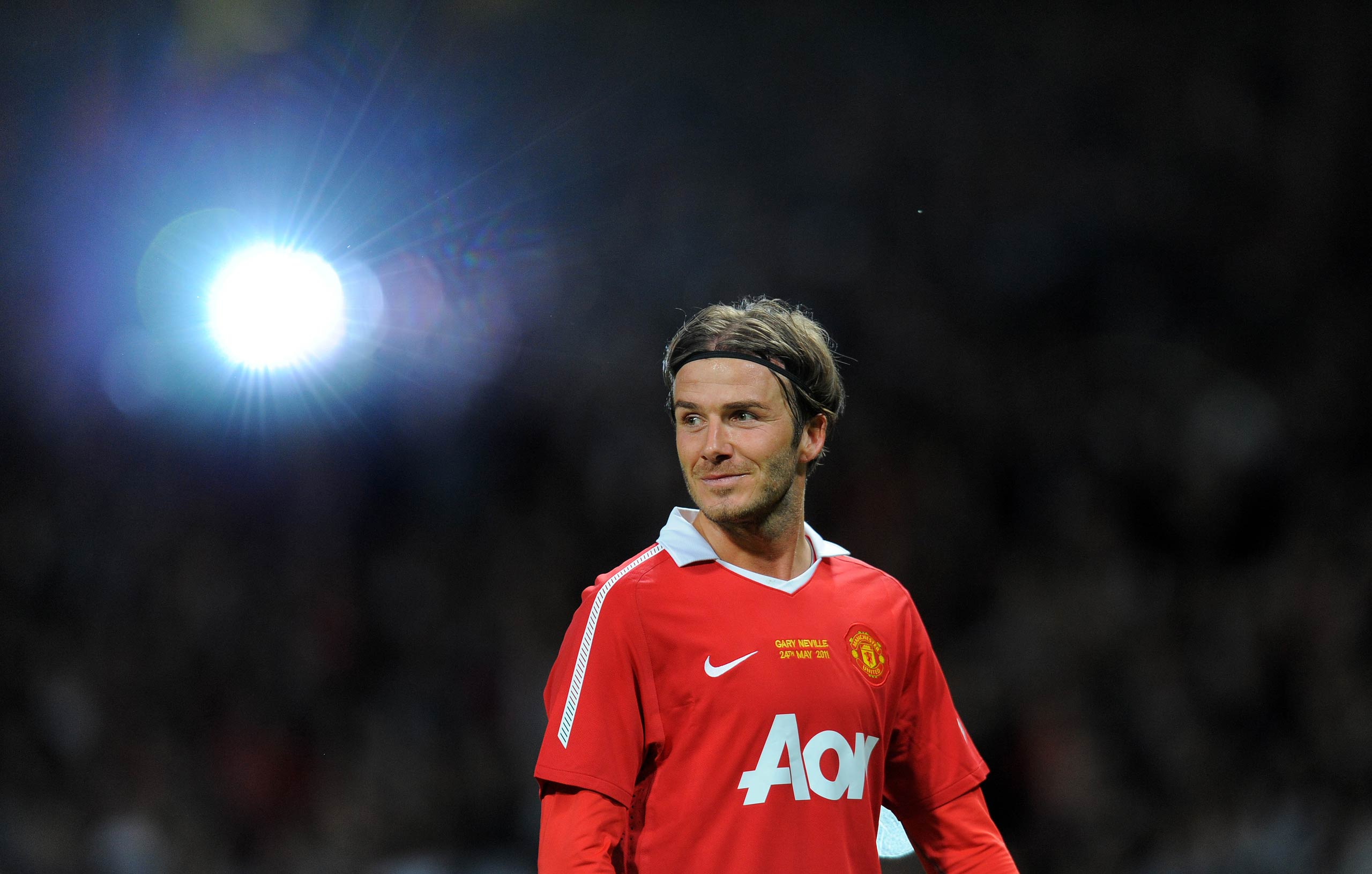 David Beckham receives applause after a testimonial football match between Manchester United and Juventus at Old Trafford in Manchester, England in 2011.