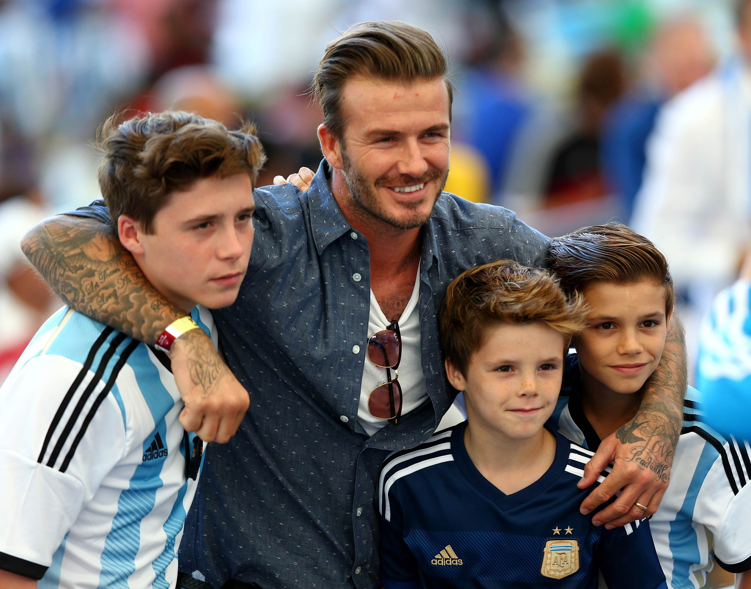 David Beckham and sons Brooklyn Beckham, Cruz Beckham, and Romeo Beckham are seen prior to the 2014 FIFA World Cup Brazil Final match between Germany and Argentina in Rio de Janeiro, Brazil in 2014.