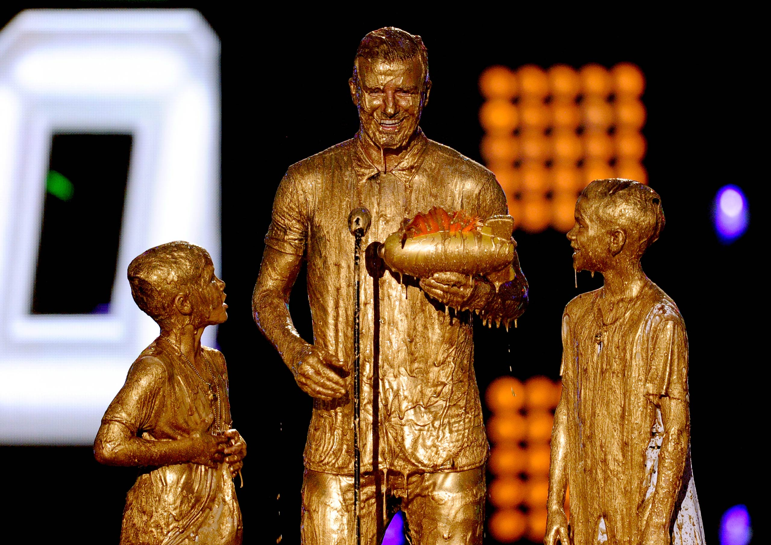 David Beckham with his sons Cruz Beckham and Romeo Beckham get slimed onstage during Nickelodeon Kids' Choice Sports Awards 2014 at UCLA's Pauley Pavilion on in Los Angeles in 2014.