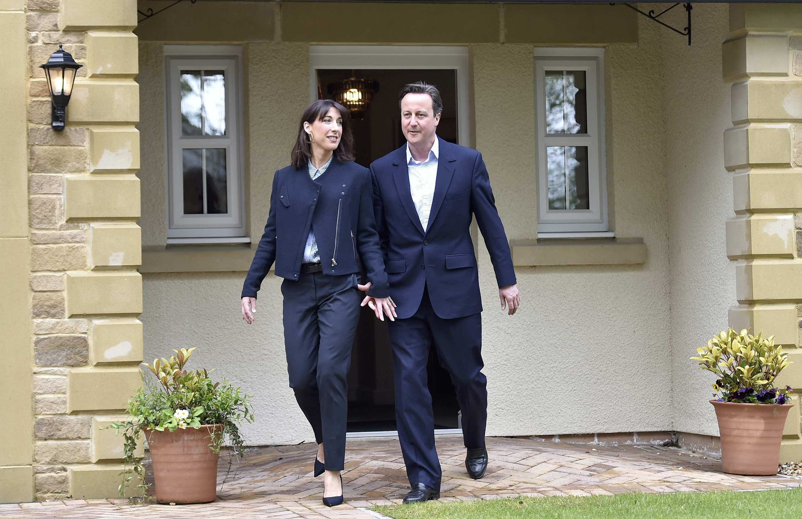 Prime Minister David Cameron and his wife Samantha during a campaign visit to a home-building scheme on May 6, 2015, in Lancaster, England