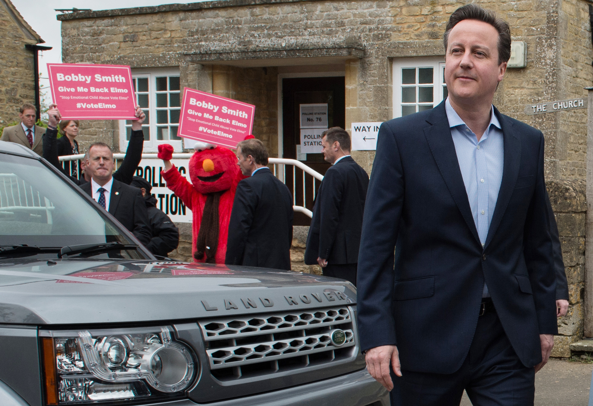 Britain's Prime Minister and Conservative Party leader David Cameron leaves the  polling station after voting in Spelsbury, England, in the general election on May 7, 2015.