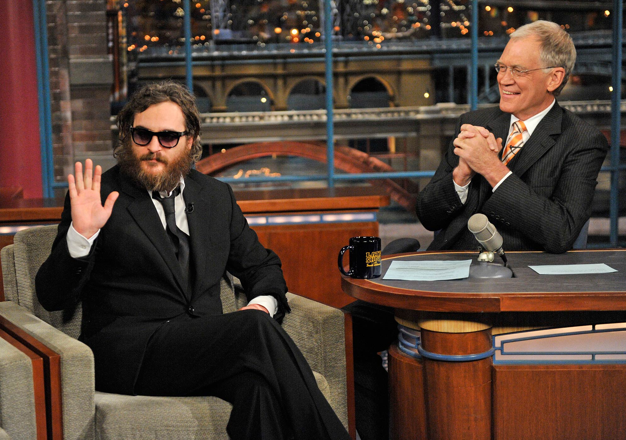 Actor Joaquin Phoenix, waves to the audience during his interview with Late Show host David Letterman during the Late Show with David Letterman on Feb. 11, 2008.