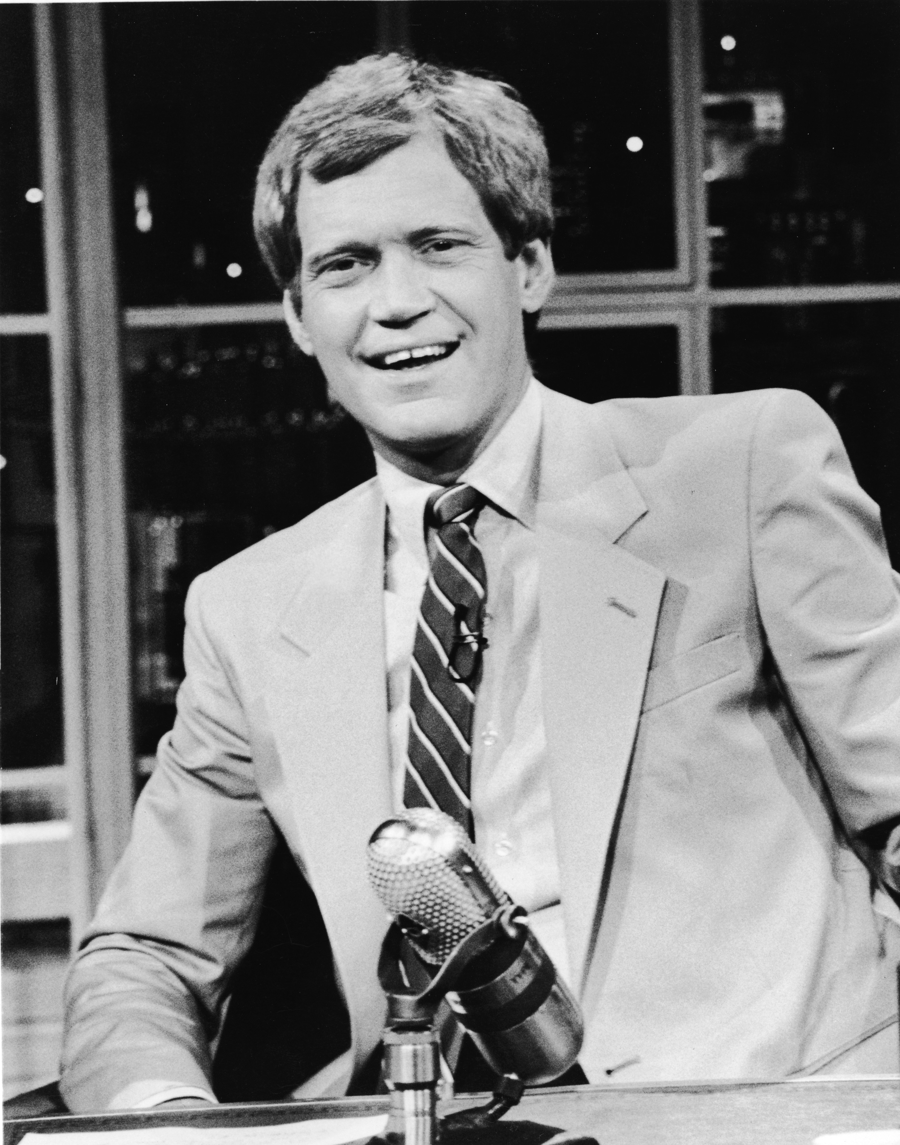 David Letterman sits at his desk on 'Late Night with David Letterman,' in New York, 1986.