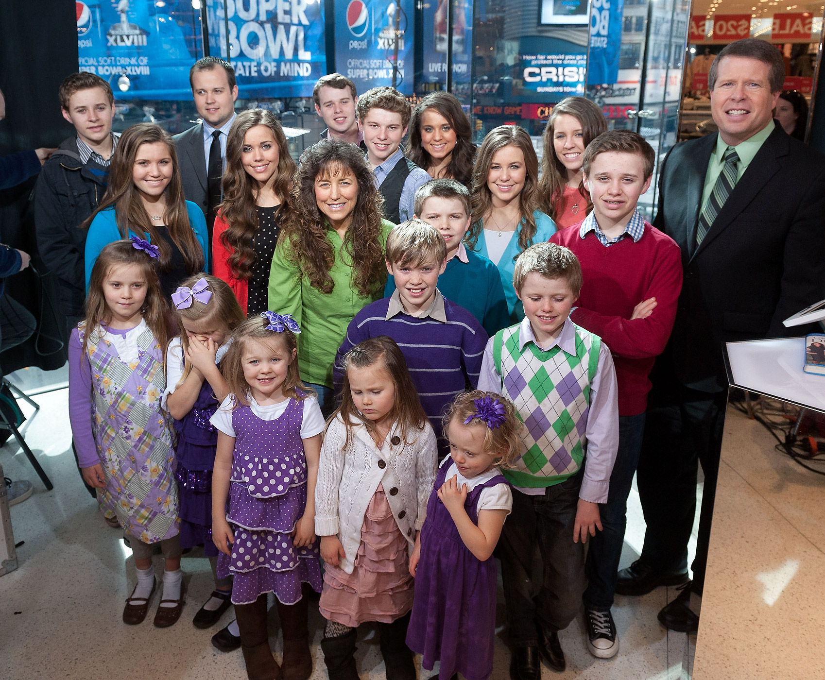 The Duggar family visits 'Extra' at their New York studio in Times Square in New York City on March 11, 2014
