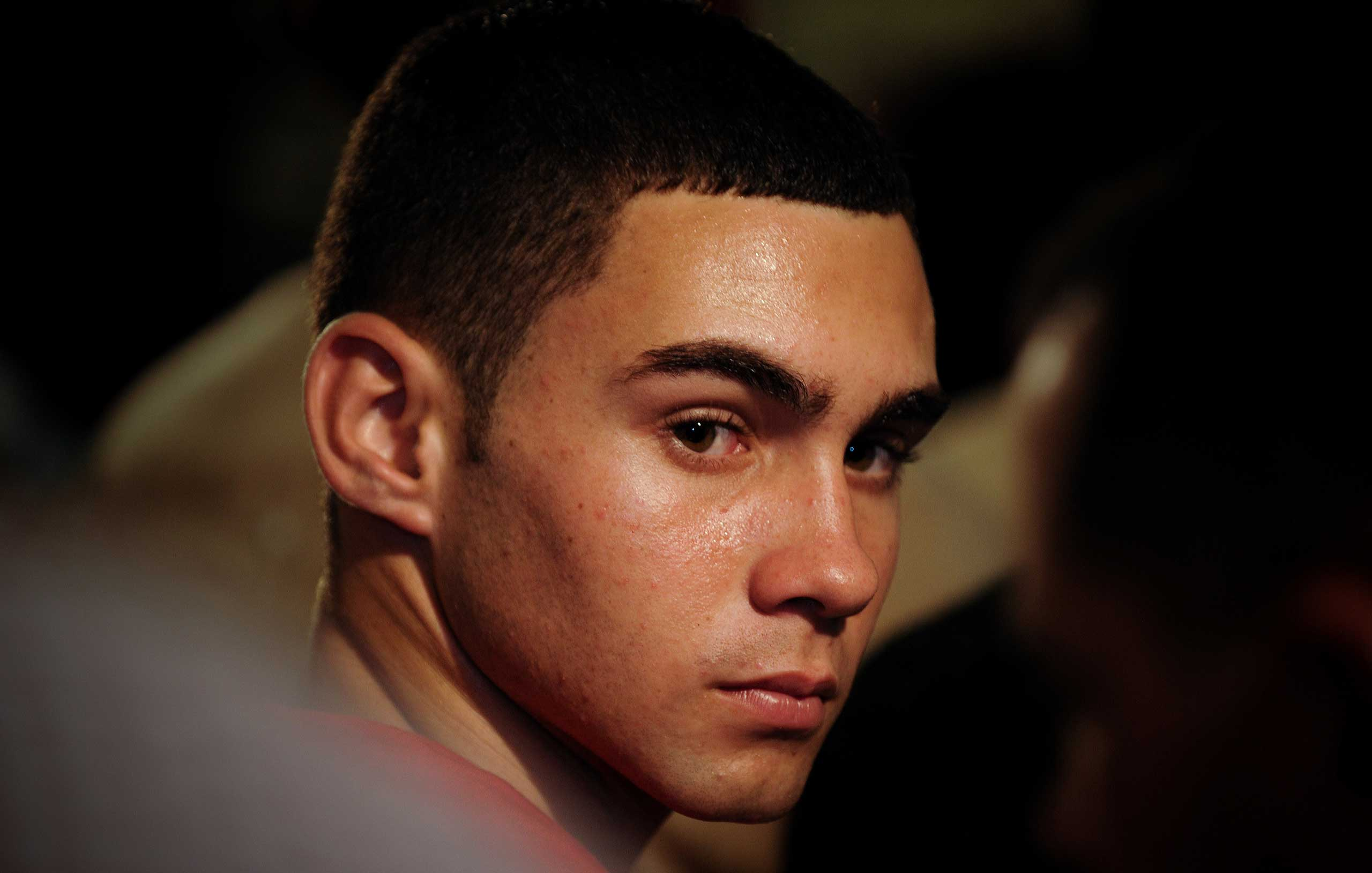 Elian Gonzalez attends an official event with Cuba's President Raul Castro, unseen, in Havana, Wednesday, June 30, 2010.