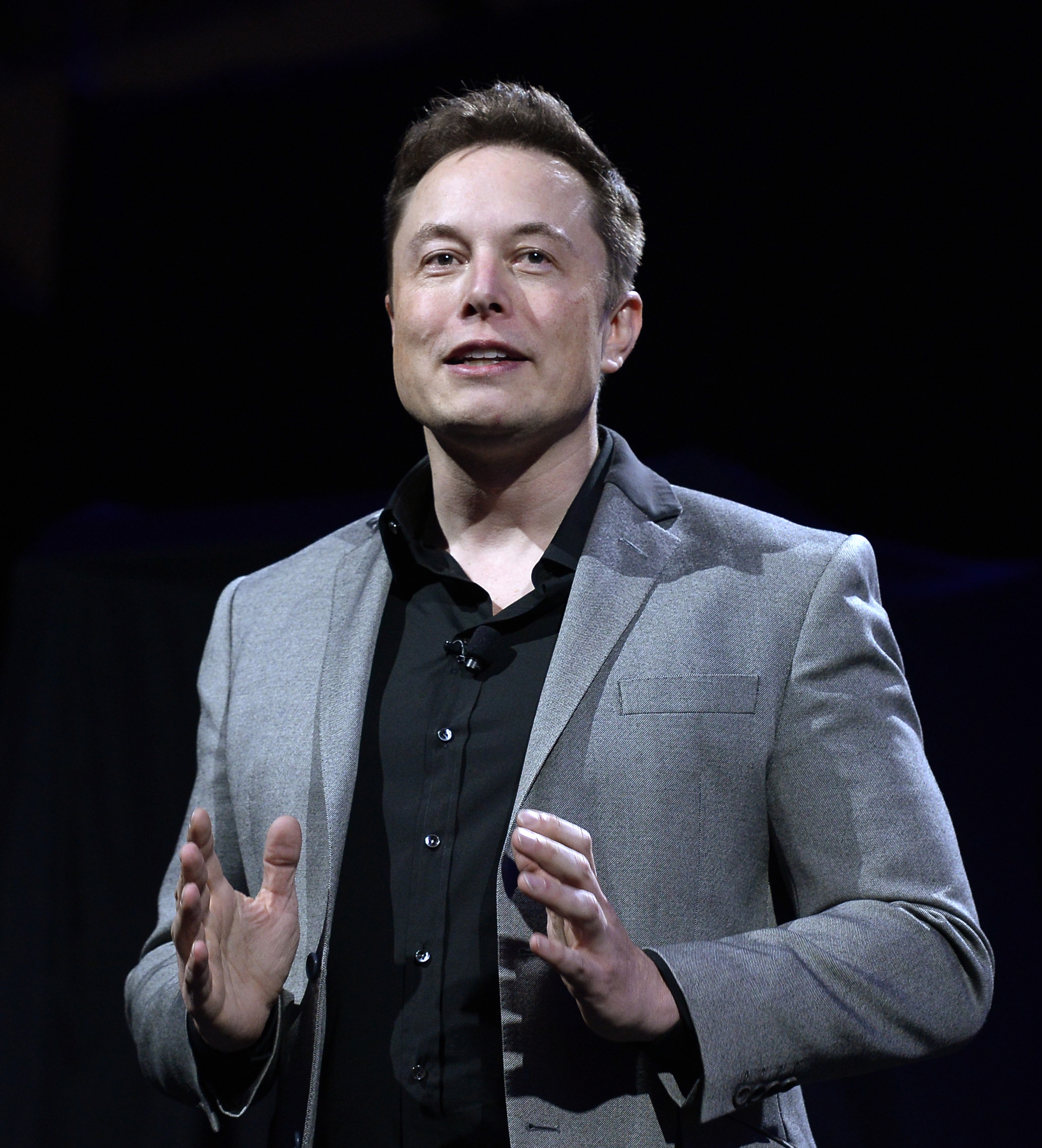Elon Musk, CEO of Tesla, unveils batteries for homes, businesses, and utilities at Tesla Design Studio April 30, 2015 in Hawthorne, California.