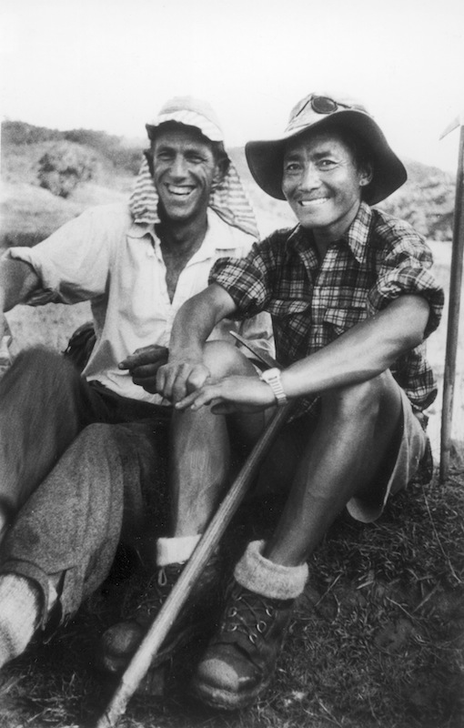 Edmund Hillary and Nepalese sherpa guide Tenzing Norgay sitting together after the pair became first to scale Mount Everest