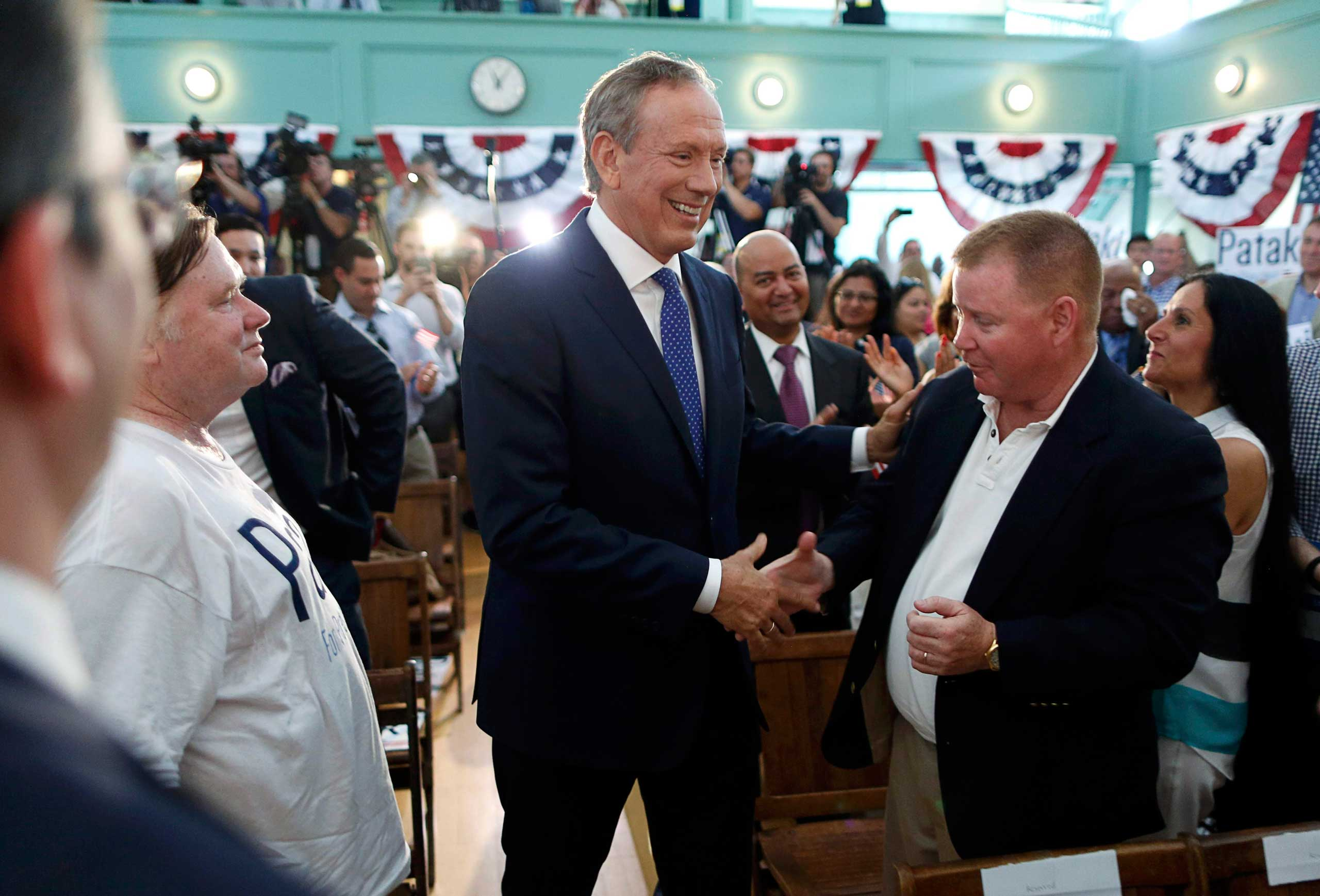Republican presidential candidate and former New York Governor George Pataki (C) greets supporters after formally announcing his candidacy for the 2016 Republican presidential nomination in Exeter, N.H. on May 28, 2015.