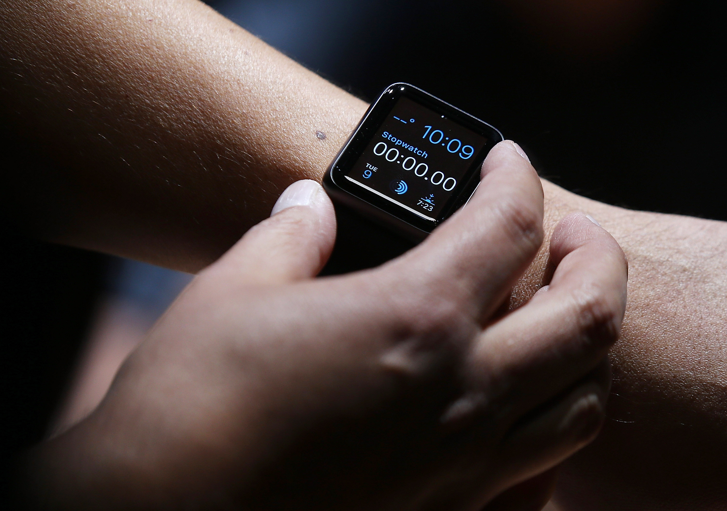 An attendee inspects the new Apple Watch during an Apple special event at the Flint Center for the Performing Arts on September 9, 2014 in Cupertino, California.