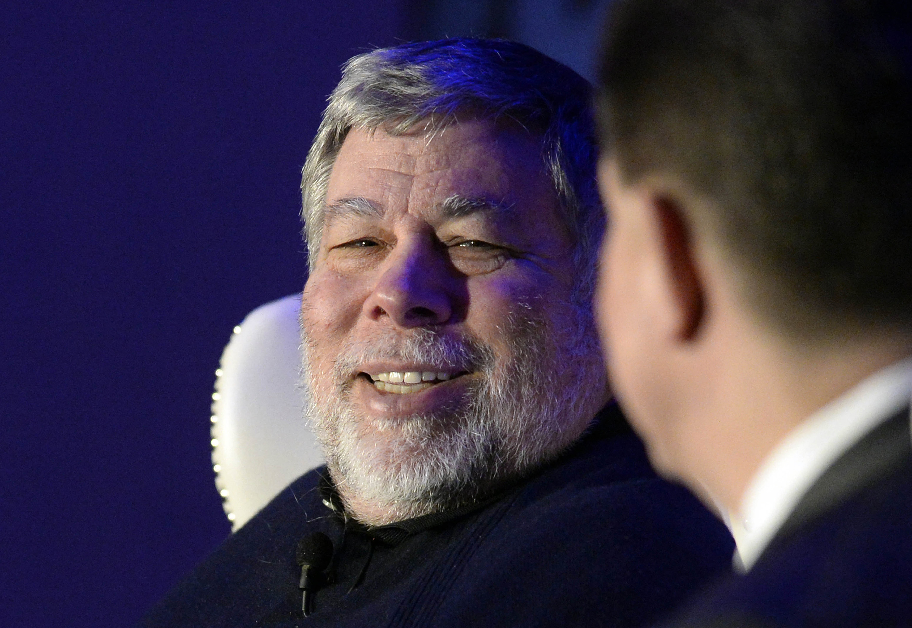 Apple co-founder Steve Wozniak, left, smiles as he answers a question from moderator Mike McGuire during the keynote luncheon of the 9th annual Southeast Venture Conference and Digital Summit Charlotte at the Le Meridien Charlotte on Wednesday, April 1, 2015, in Charlotte, N.C.