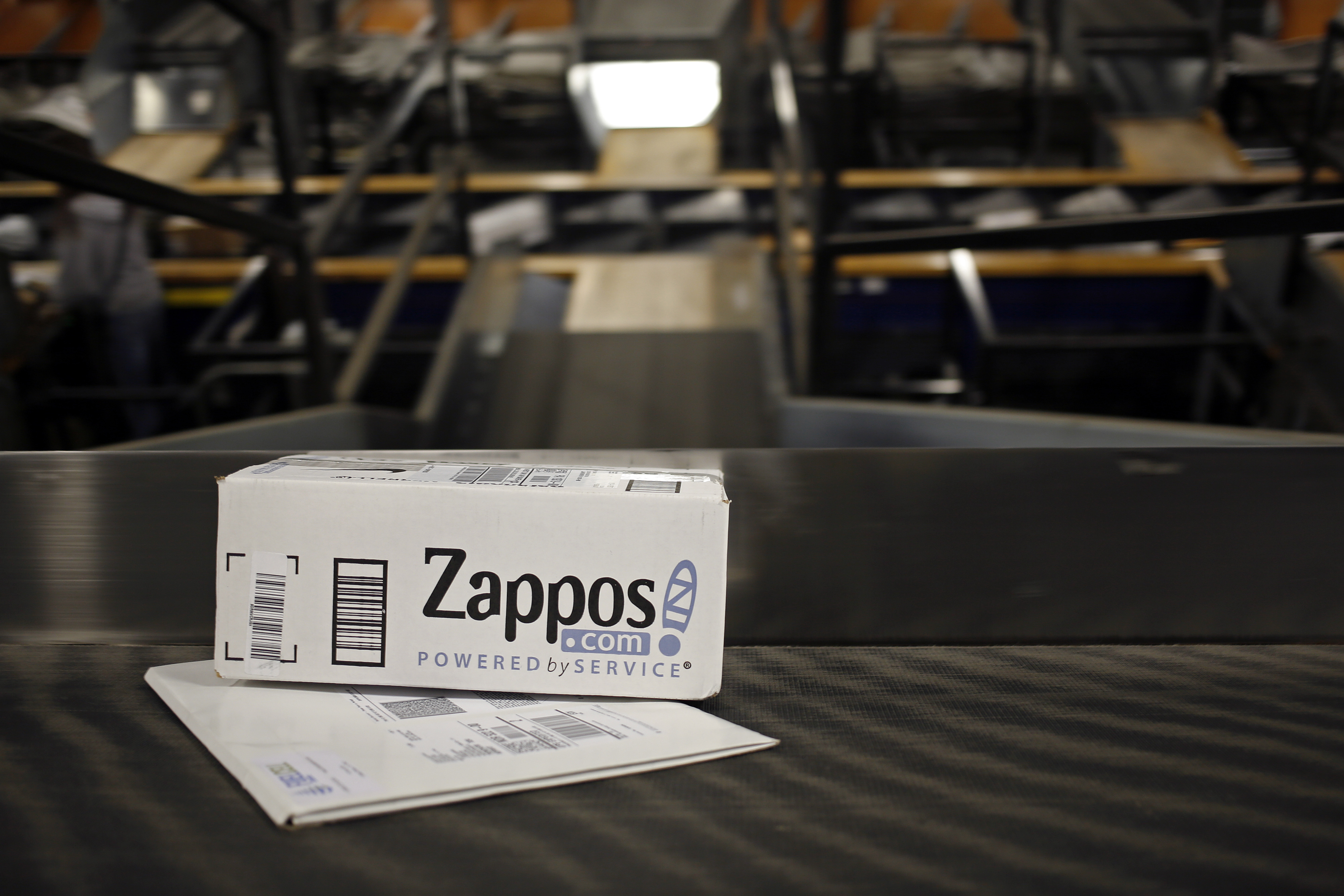 A package from Zappos.com moves down a conveyor belt during the afternoon sort at the United Parcel Service Inc. (UPS) Worldport facility in Louisville, Kentucky, U.S., on Tuesday, April 21, 2015.