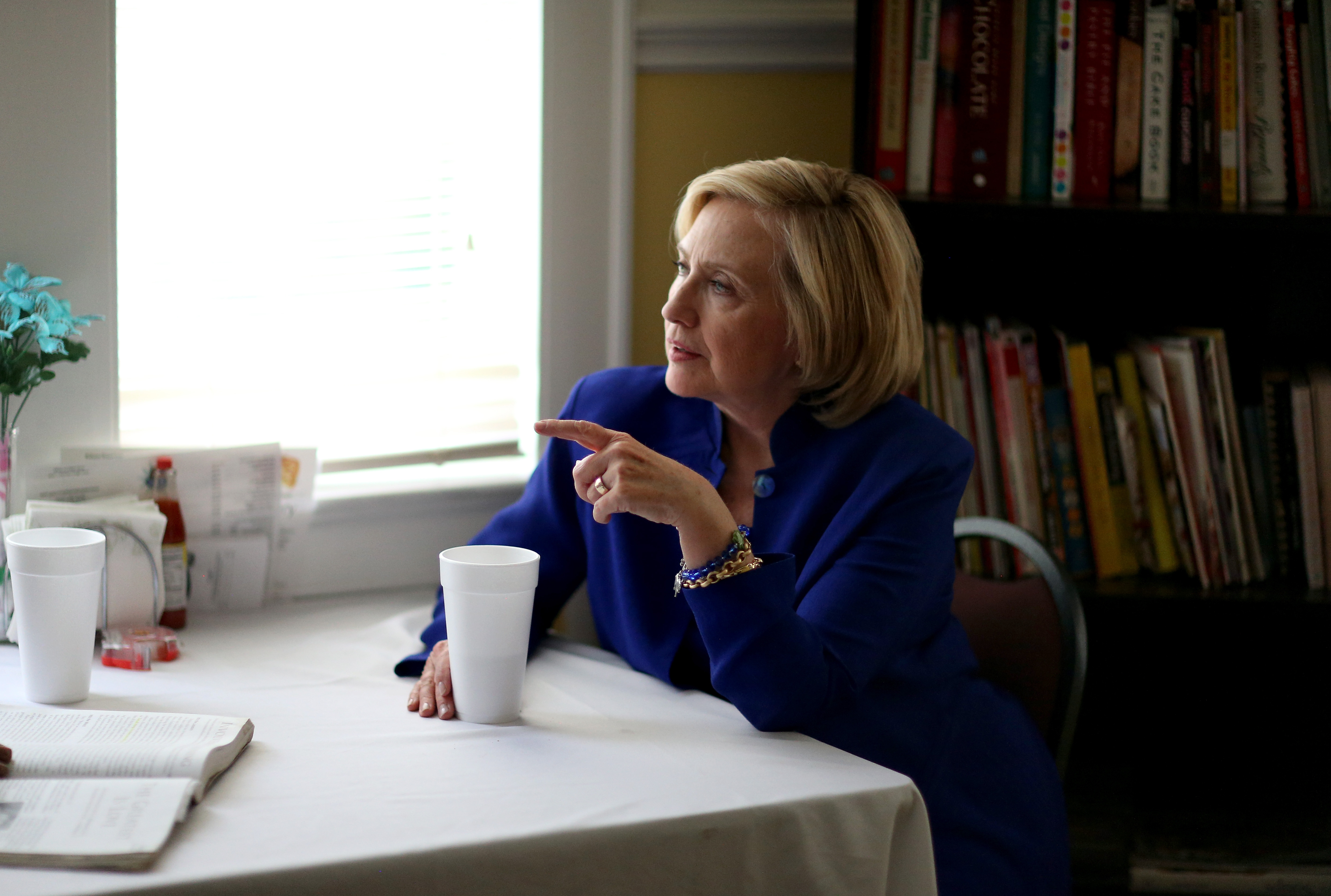 Democratic Presidential candidate Hillary Clinton sits with a customer as she visits the Main Street Bakery on May 27, 2015 in Columbia, South Carolina.
