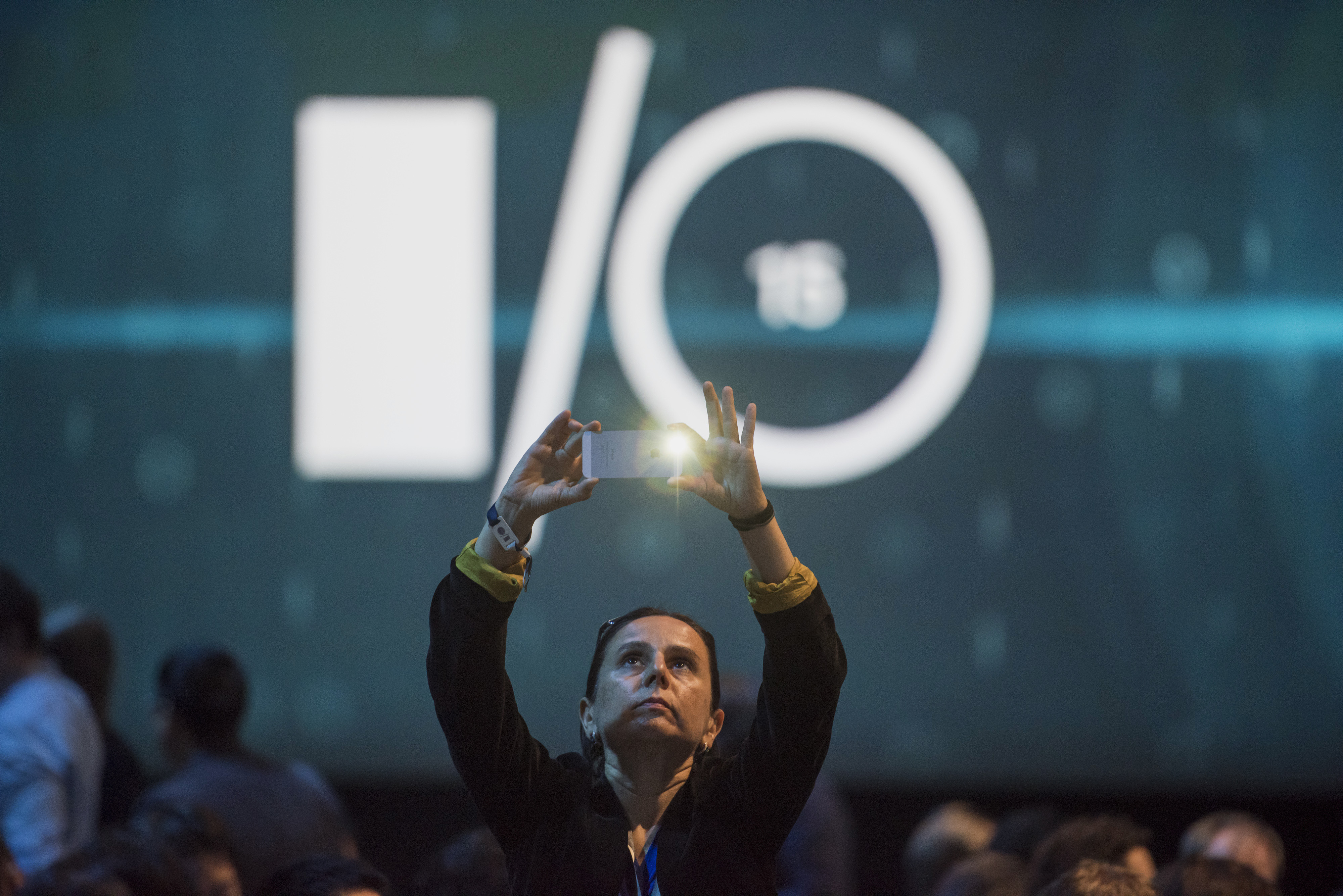 An attendee takes a photograph prior to the Google I/O Annual Developers Conference in San Francisco, California, U.S., on Thursday, May 28, 2014.