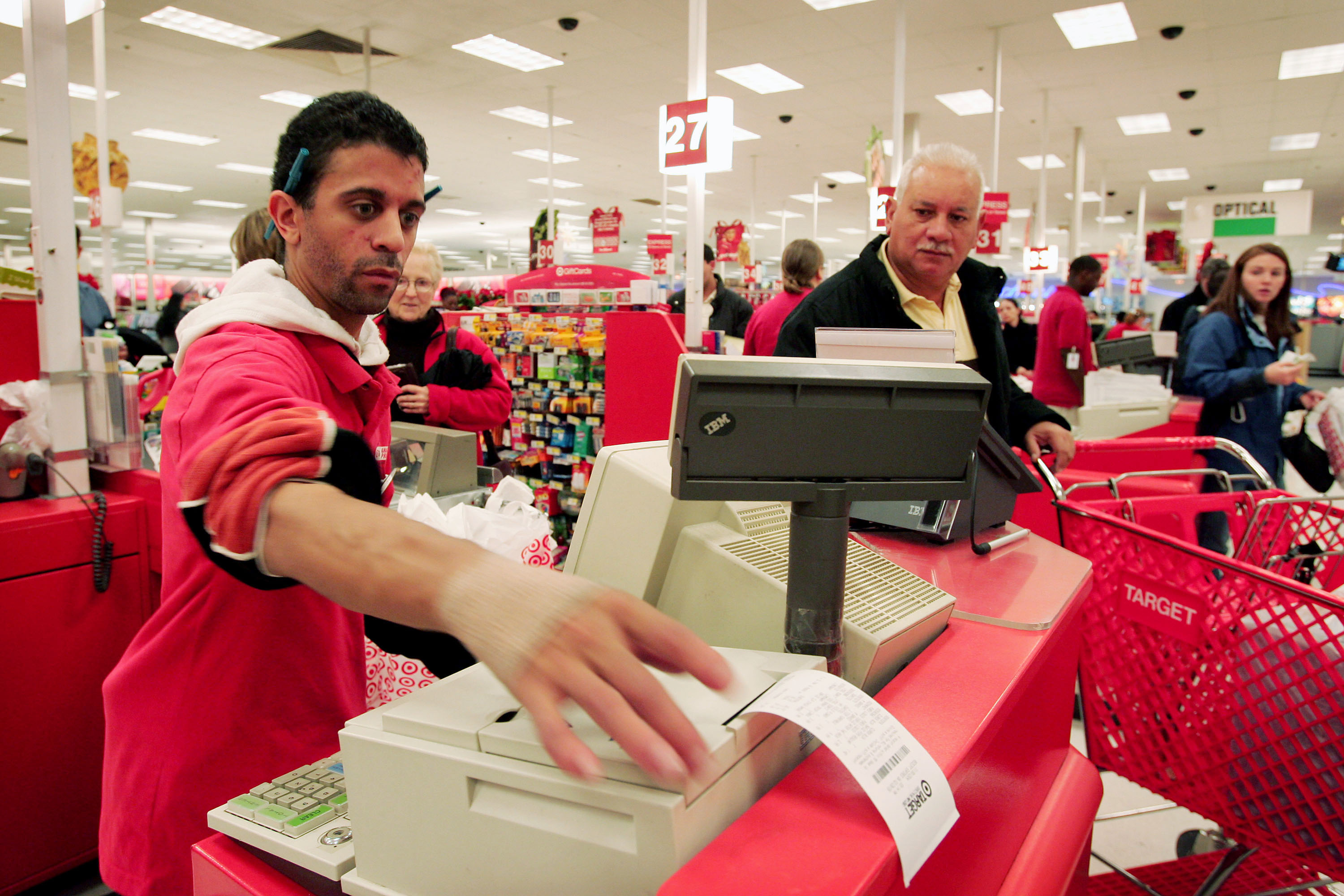 A clerk rings up sales for a customer at a Target store November 30, 2004 in Chicago, Illinois.