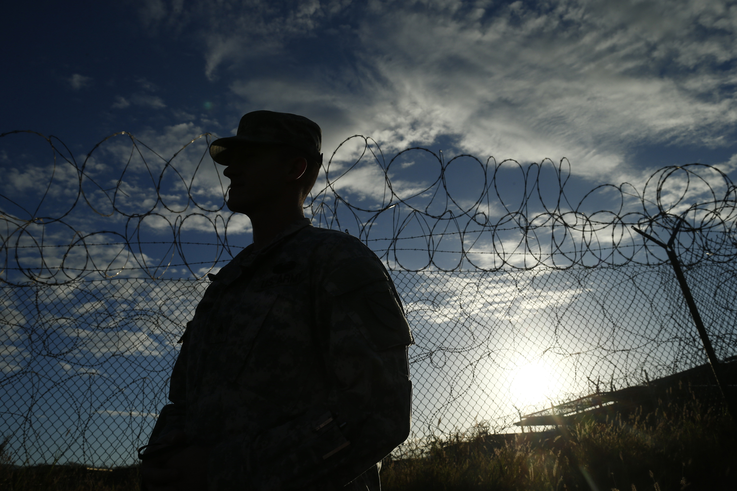 A soldier stands at the now closed Camp X-Ray, which was used as the first detention facility for al-Qaeda and Taliban militants who were captured after the Sept. 11, 2001, attacks, at Guantánamo Bay Naval Base, Cuba, on Nov. 21, 2013